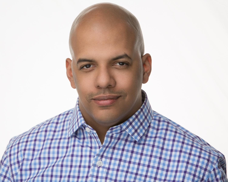 Argin Hutchins Audio Headshot in Orlando Blue Shirt