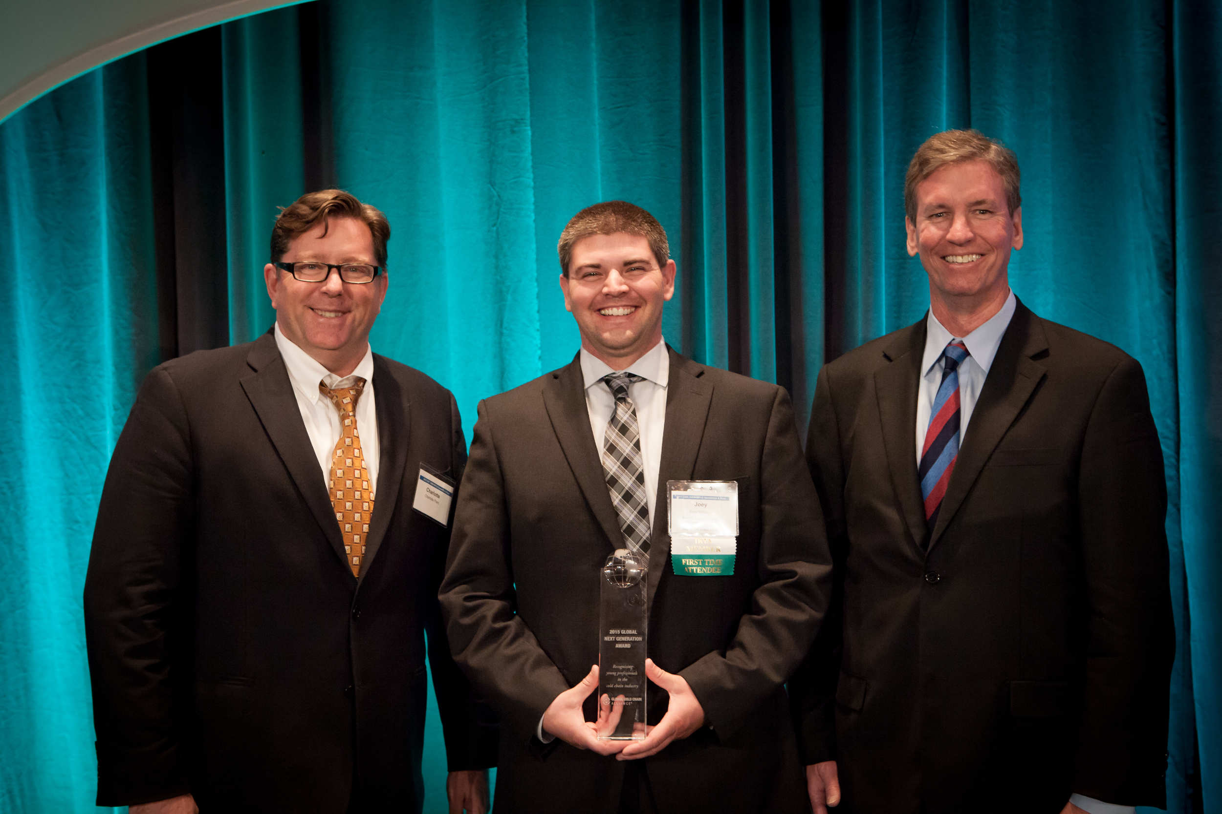 2014-2015 WFLO Chairman Frank Plant (left) and 2014-2015 IARW Chairman Tom Poe (right) pictured with the 2015 GCCA Global NextGen Award winner Joey Williams.
