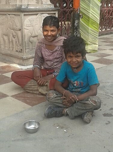 These two boys were hired to cook and clean for a family like Shanker.