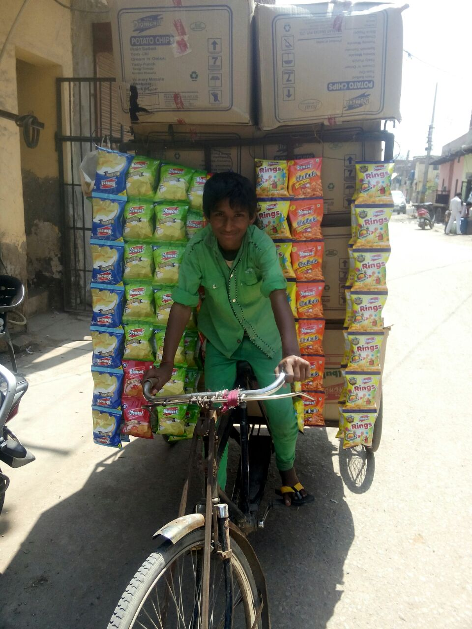 This boy works as a warehouse laborer. He transports snack items from the warehouse to different stores.
