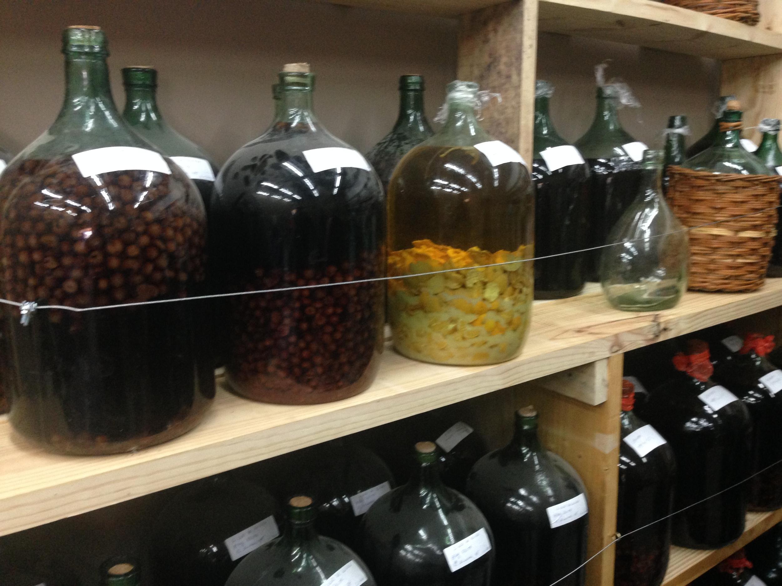 Fruit liqueurs aging in vintage bottles.