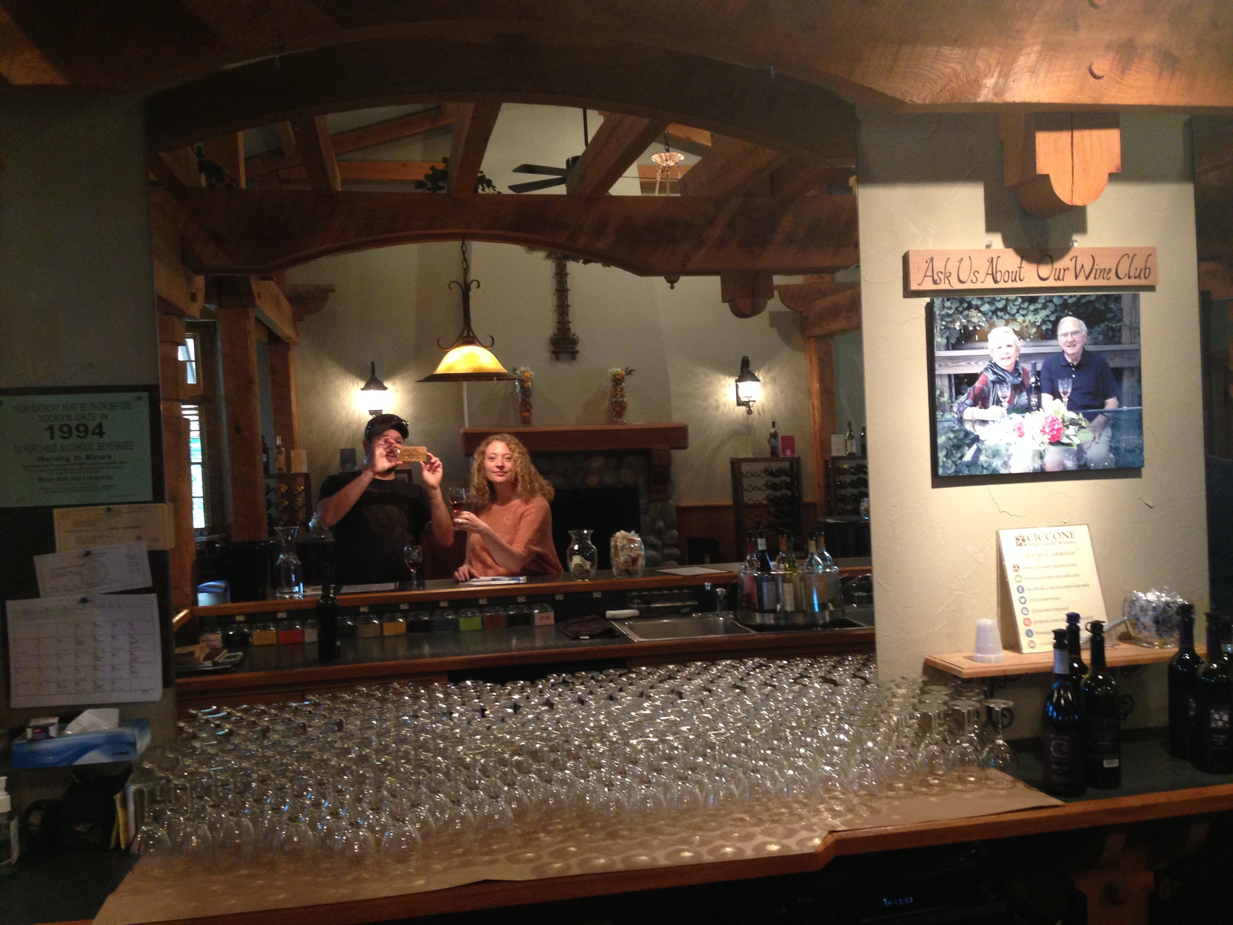 Gabe and I in the tasting room, snapping a photo of a photo of Silvio and his wife, Joan.