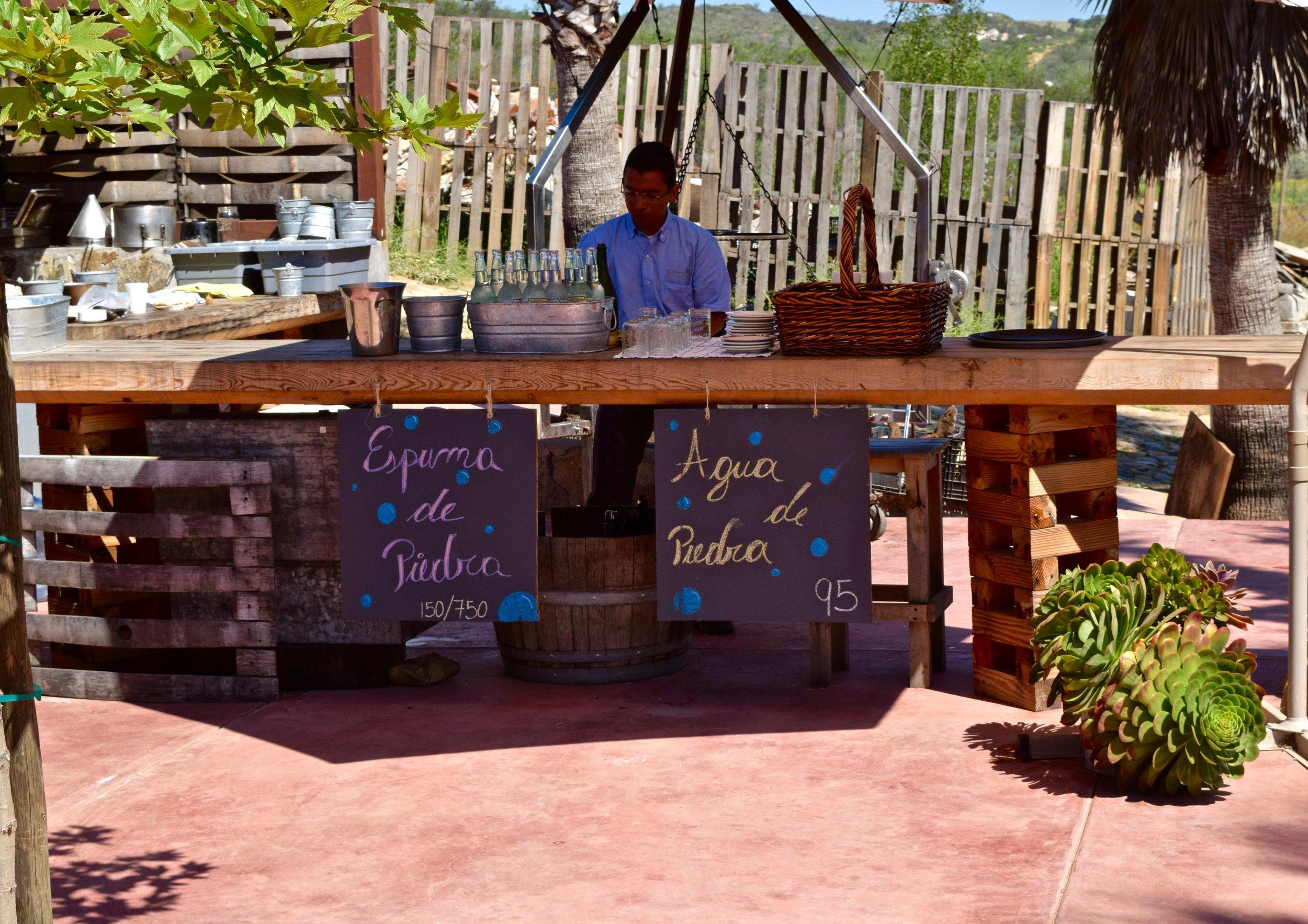 casa de piedra- pourer at bar.jpg