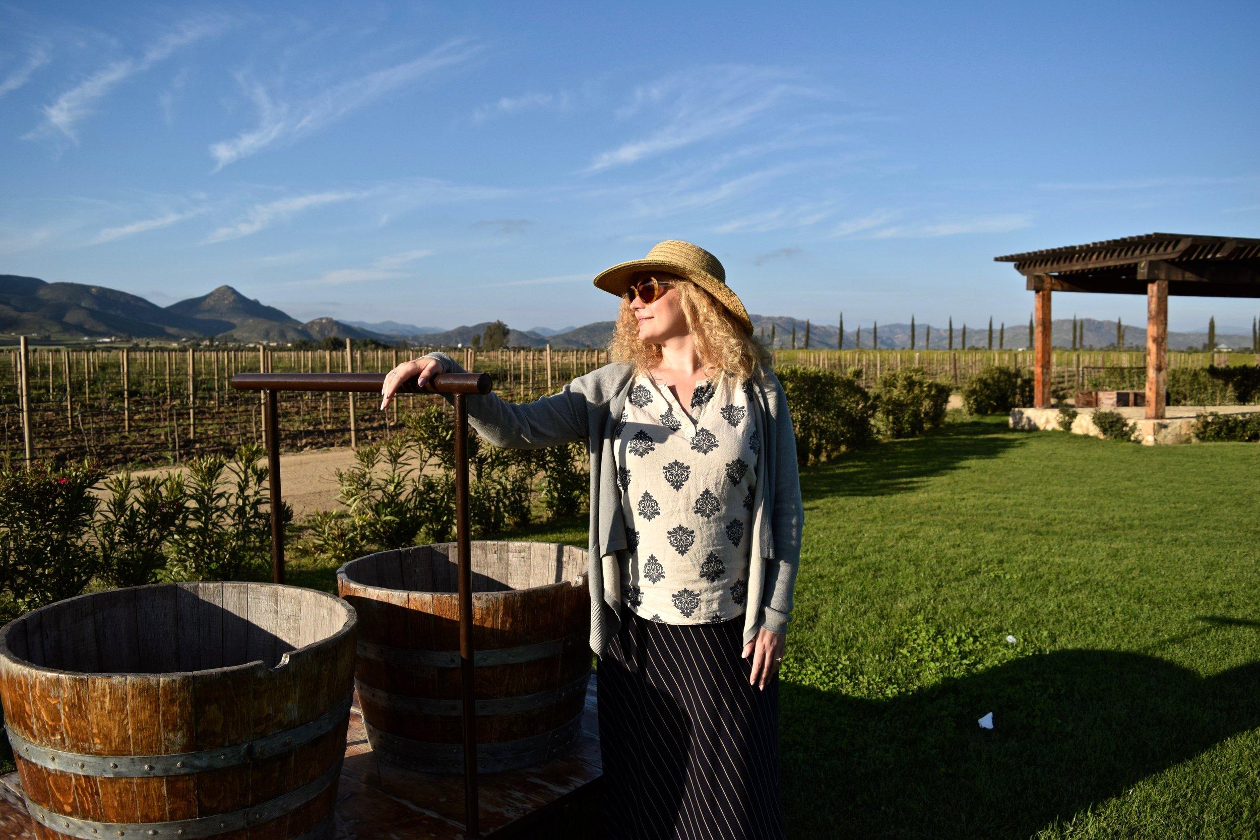 el cielo- joanna near half wine barrels.jpg
