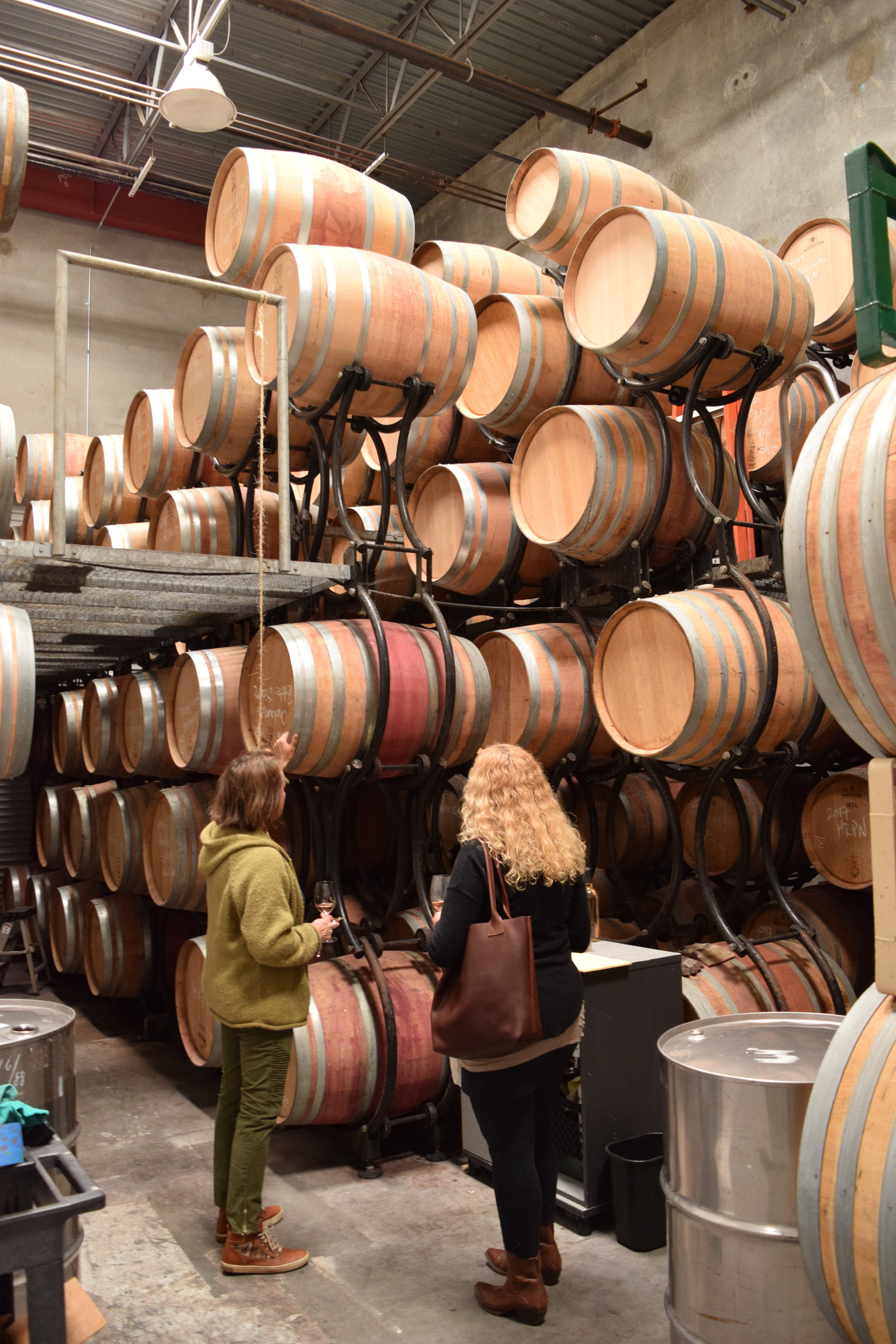 Annette explains the barrel system used at Cima Collina. No barrel aging for the pet-nat but their reds certainly do. Photo by Gabriel Manzo.