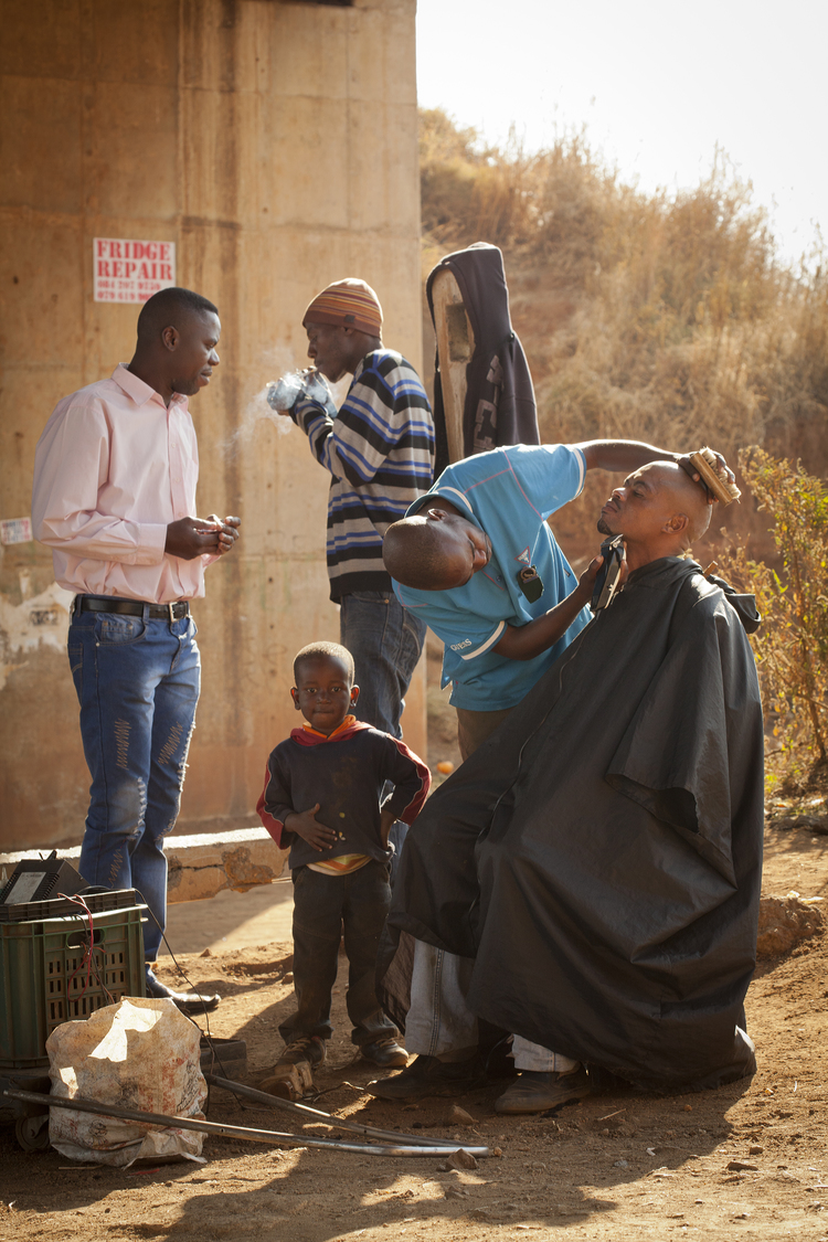 Outdoor Barber, photograph by Heather Mull.    Purchase info