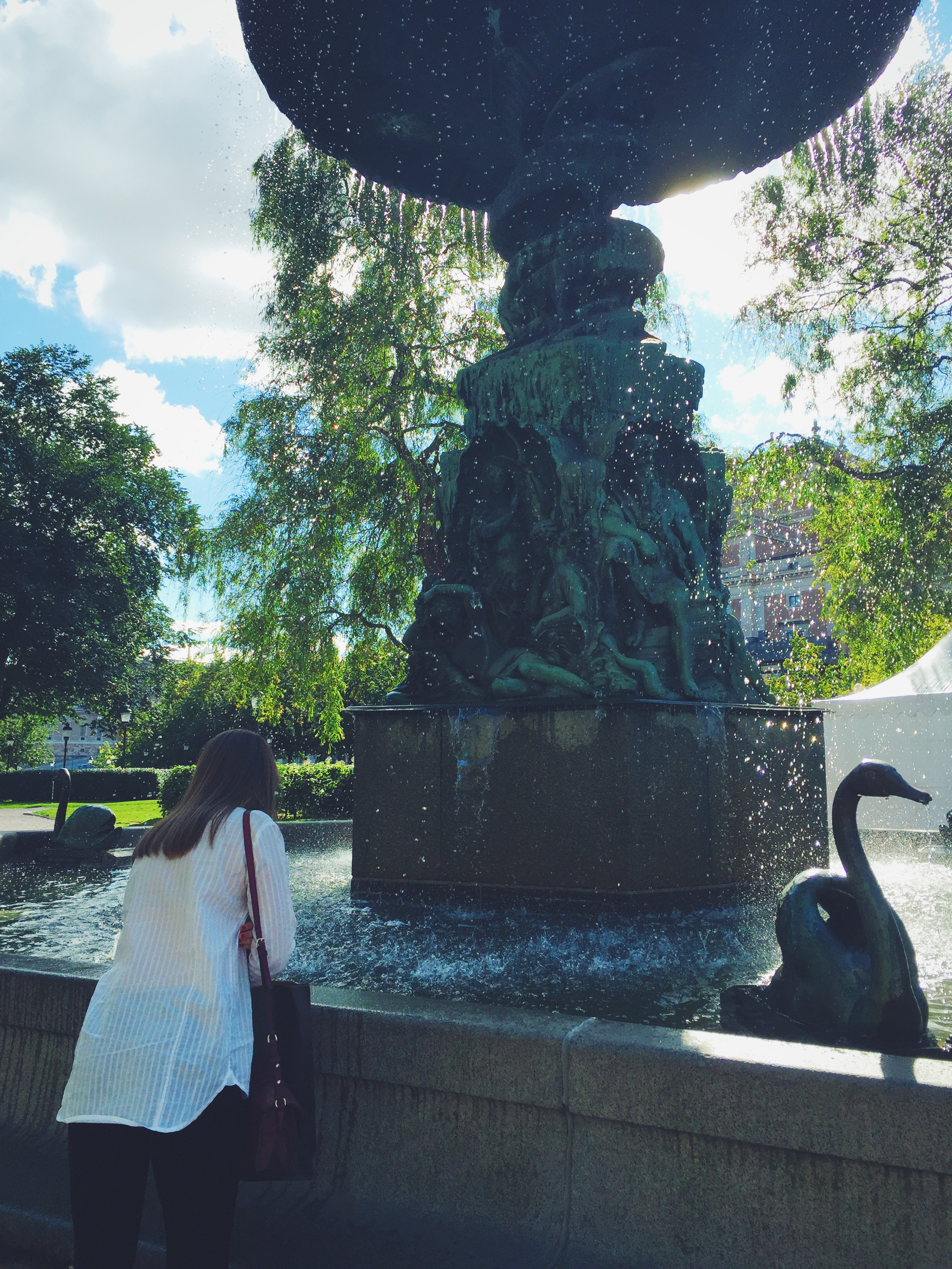 Anna with a fountain in Stockholm.