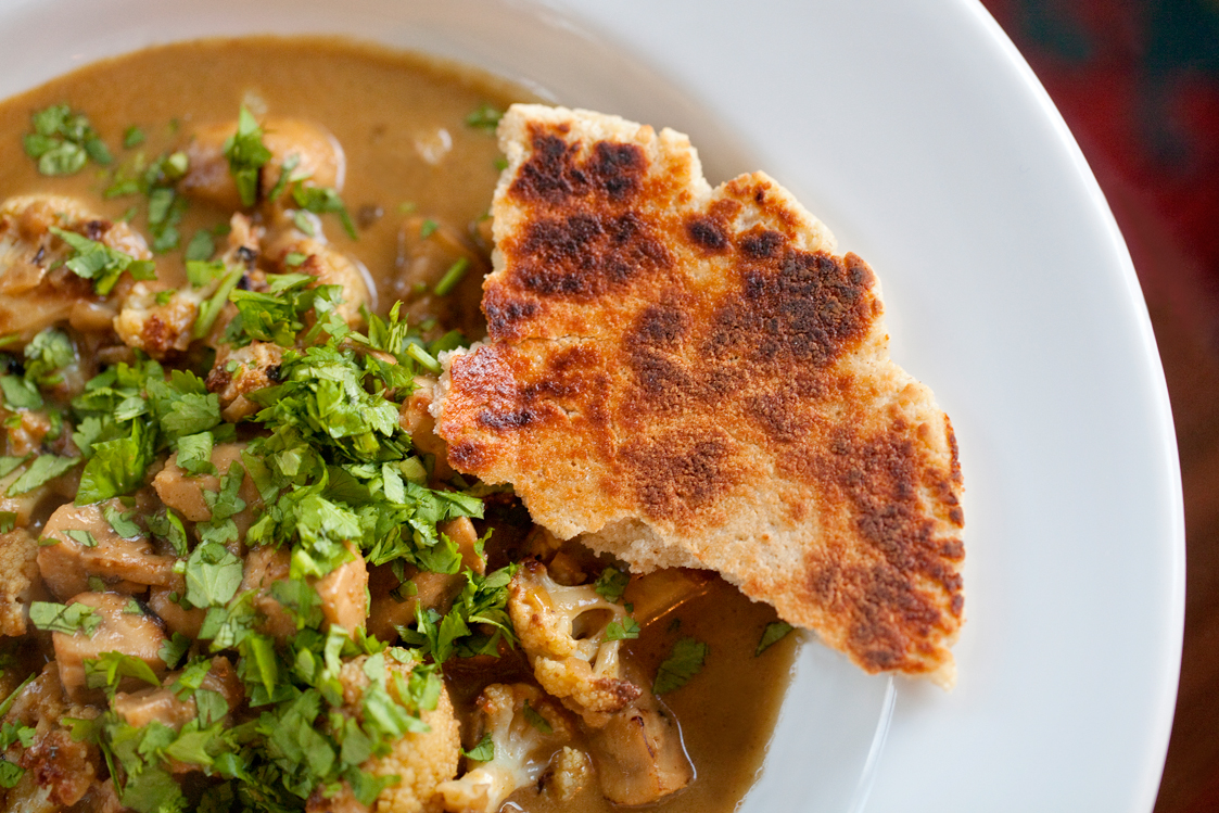 Grain-free, gluten-free Primal Naan Bread is the perfect sharing bread to eat with curries and Indian food, shown here with Cauliflower & Mushroom Curry