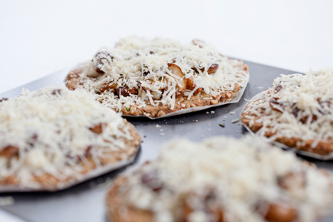 The part-cooked, grain-free pizza bases, topped with mushroom and cheese, before returning to the oven
