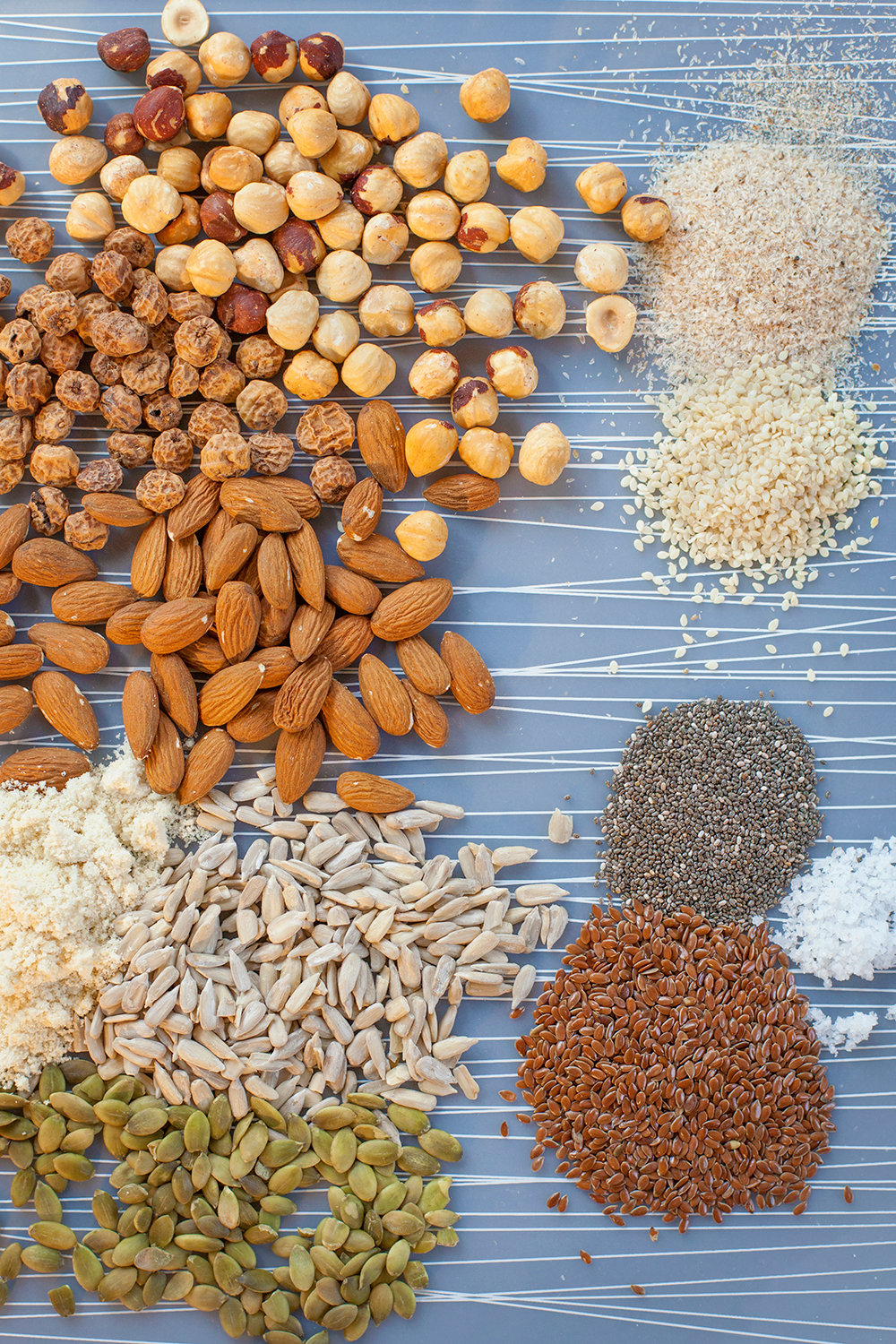 Clockwise, from top right: psyllium husk; sesame seeds, chia seeds, sea salt, flaxseeds, pumpkin seeds, sunflower seeds, ground almonds, whole almonds, tiger nuts, whole hazelnuts