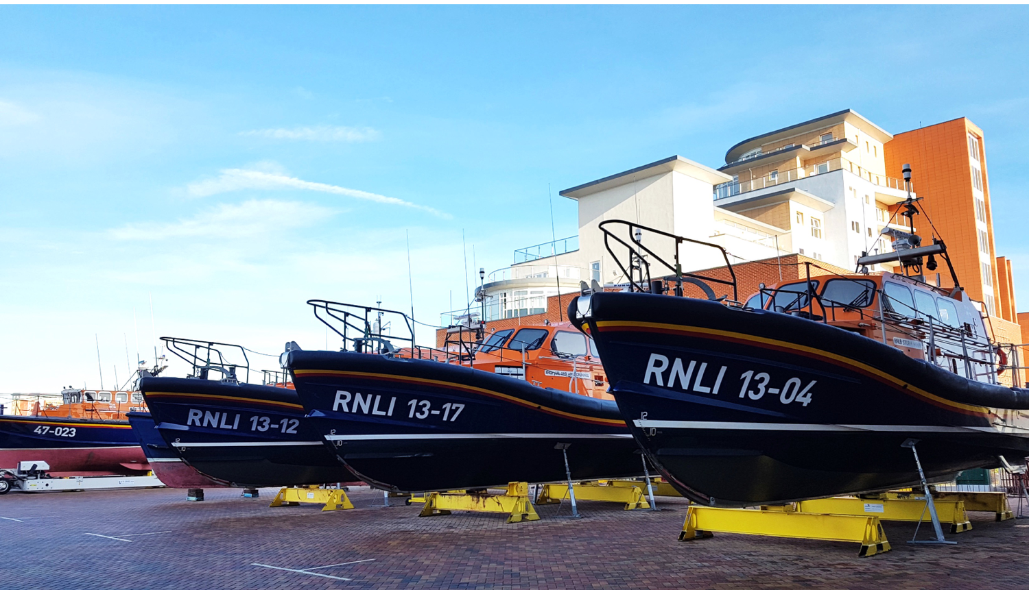 Some lifeboats from the Royal National Lifeboat Institution.