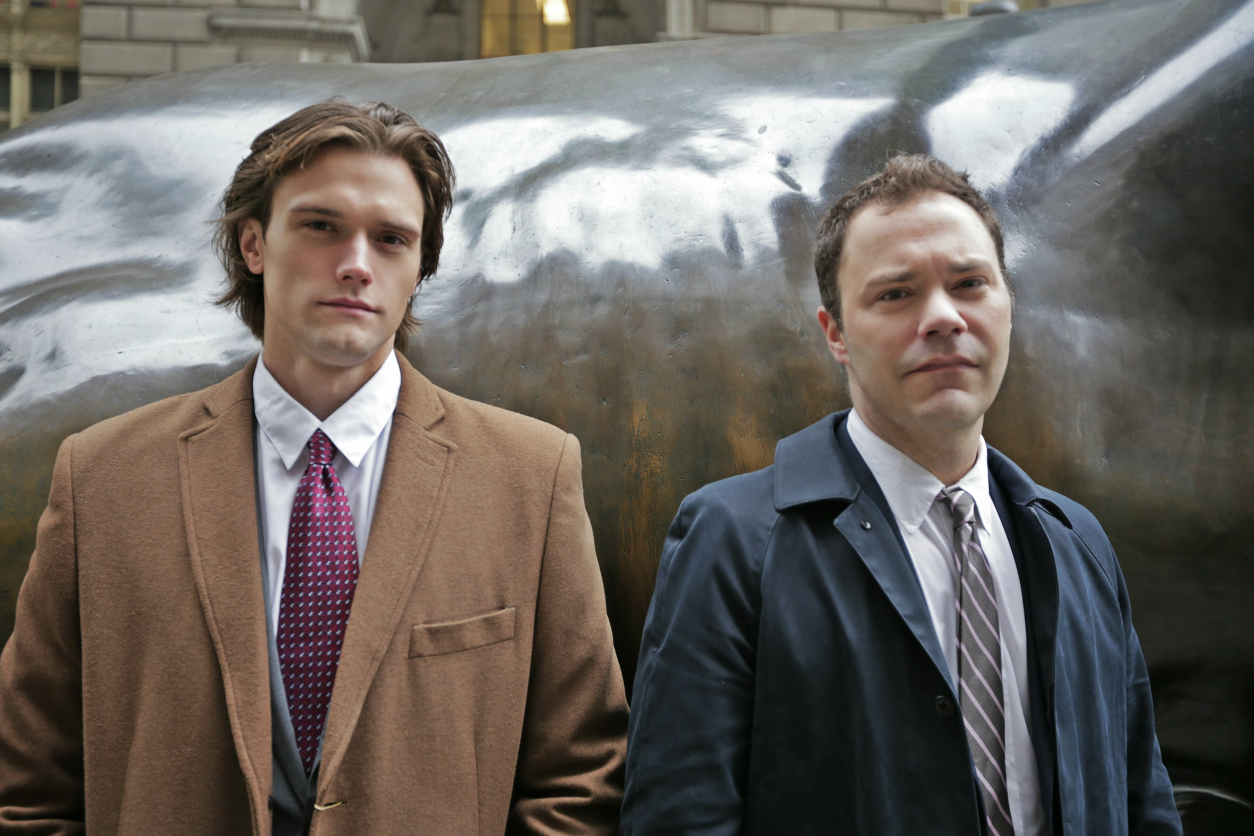 Hartley Sawyer and Wilson Cleveland in front of the Wall Street bull.
