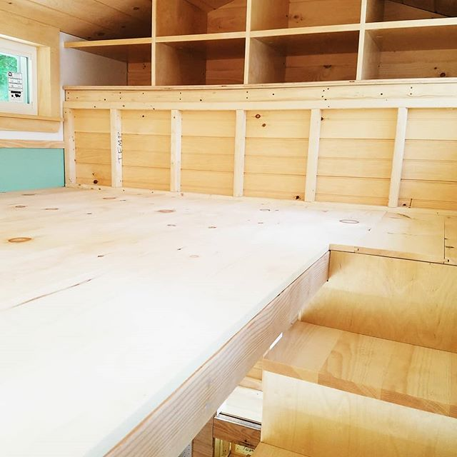 Some shots of the almost completed loft! It went up so quickly yesterday and really ties the whole space together - now it's a (tiny) house! . There is, surprisingly, loads of headroom up here, lots of natural light, and storage cubbies too. . Can you see yourself in a loft like this? . #tinyhouse #tinyhousecrafters #loft #ourbuilds #tinyhouseloft #thow #tinyhousebedroom #creativestoragesolutions #wood  #stairs #storage