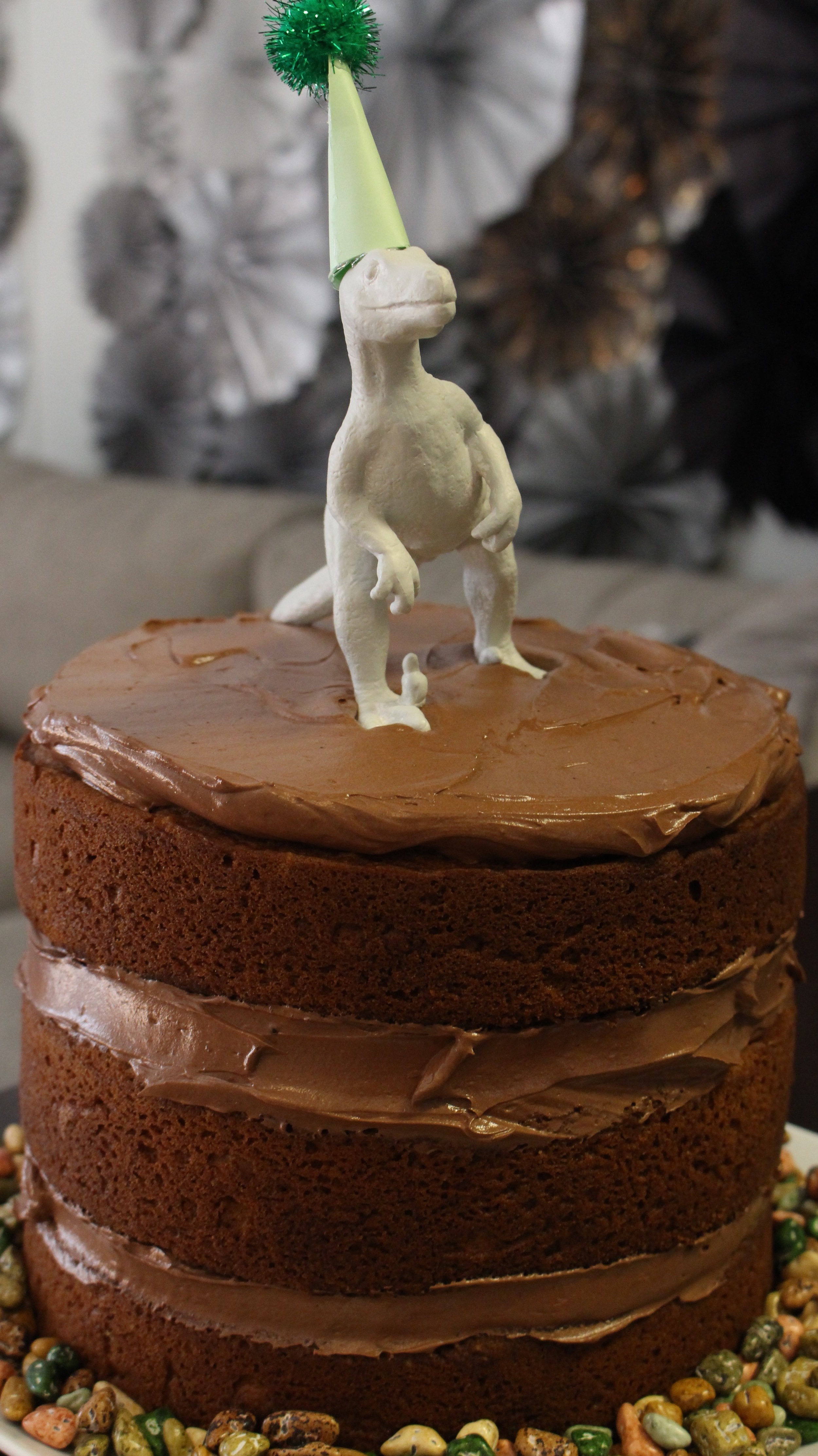 Cake! Don't forget the chocolate rocks underneath. #Moderdino #dinosaurs #firstbirthday #dinobirthdayparty #kidsbirthday #meandthemoose