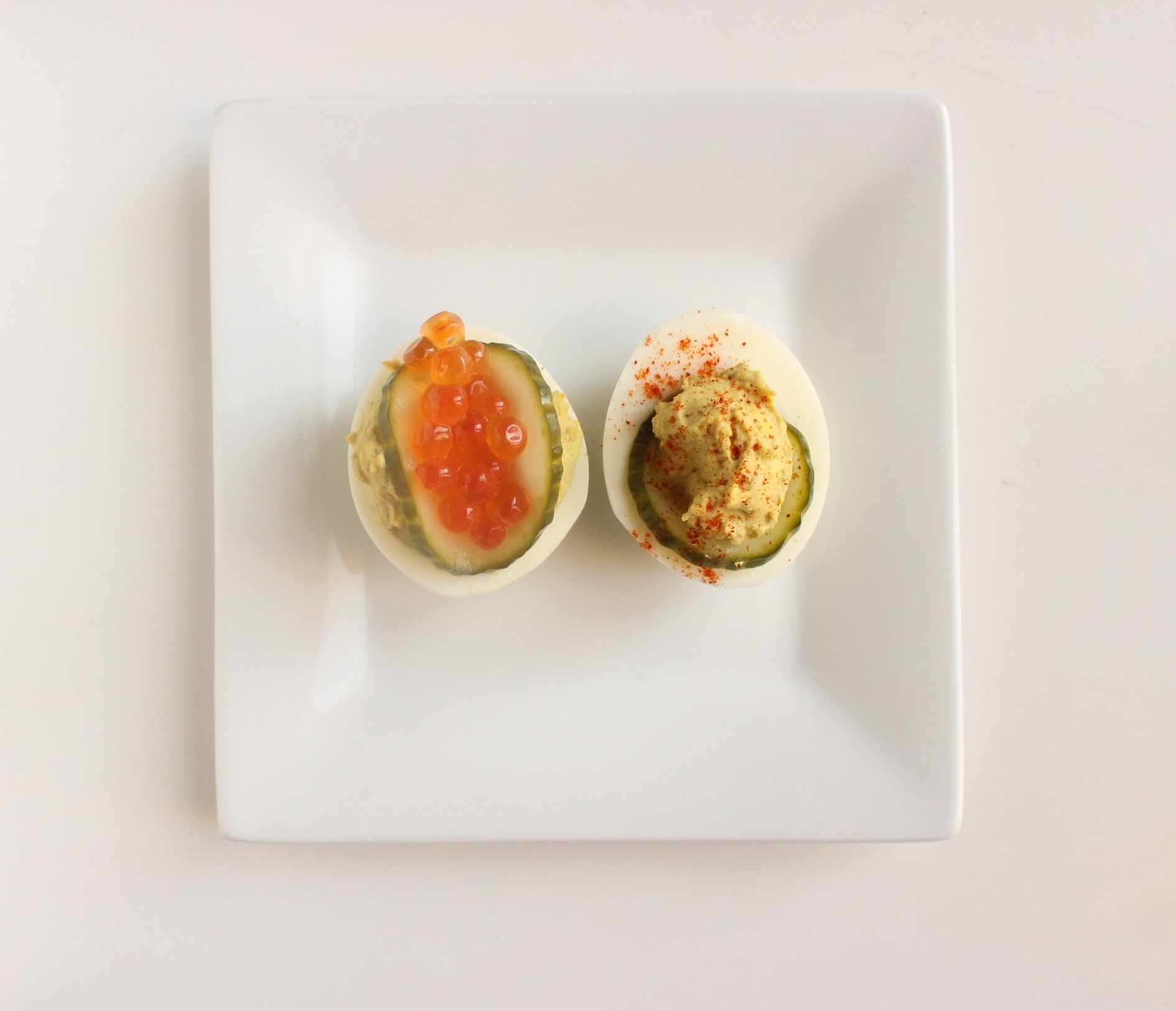 Deviled eggs | Me & The Moose. These deviled eggs provide a tasty hit of salt and protein to satisfy snack cravings. #meandthemoose #whole30 #whole30recipes #deviledeggs #snacks #snackrecipes