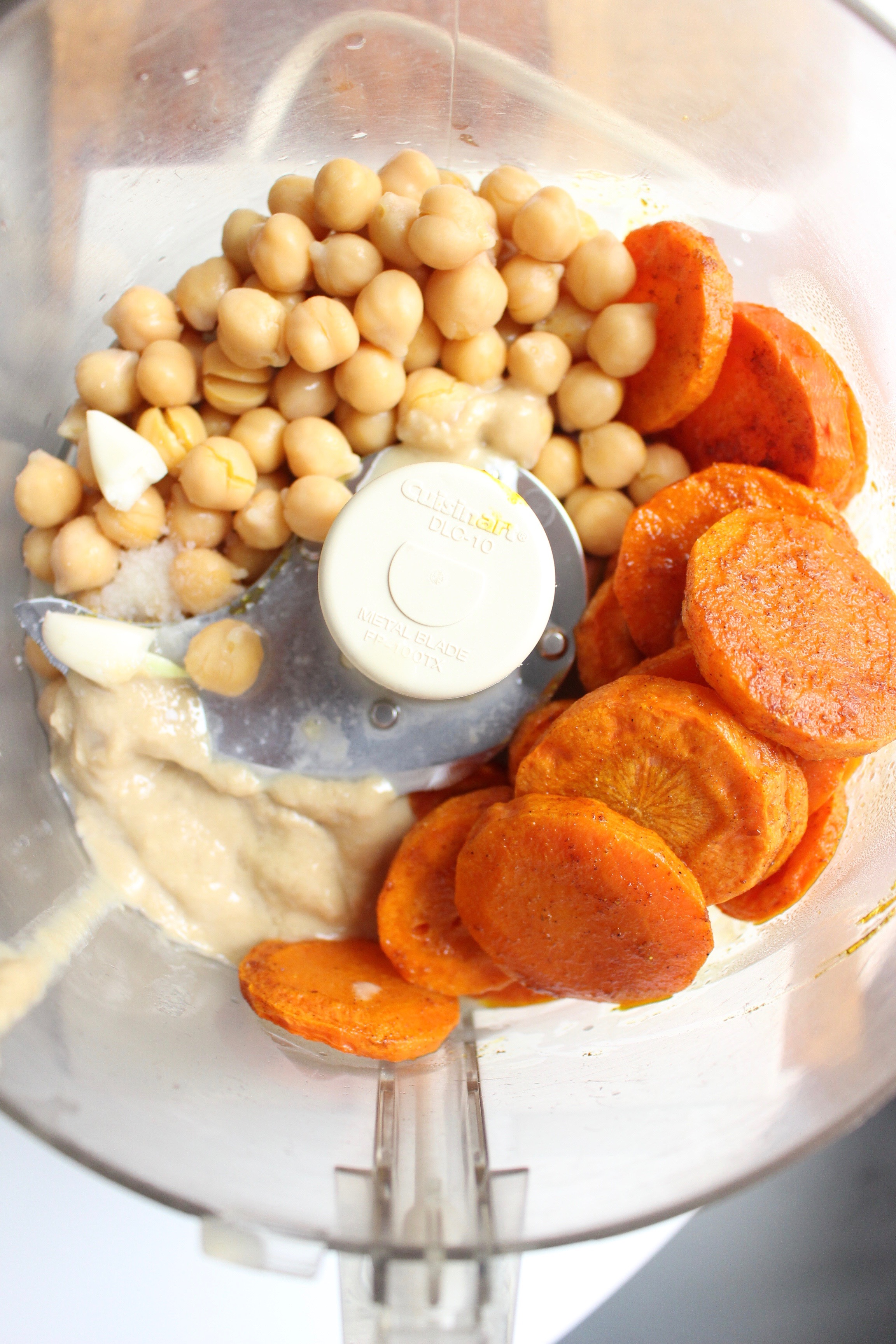 Roasted carrot hummus | Me & The Moose. Roasted carrots sweeten up this spicy, complex, EASY hummus. #meandthemoose #snackrecipes #hiddenveggies #snacks #roastedcarrots #hummus #homemadehummus #hummusrecipes