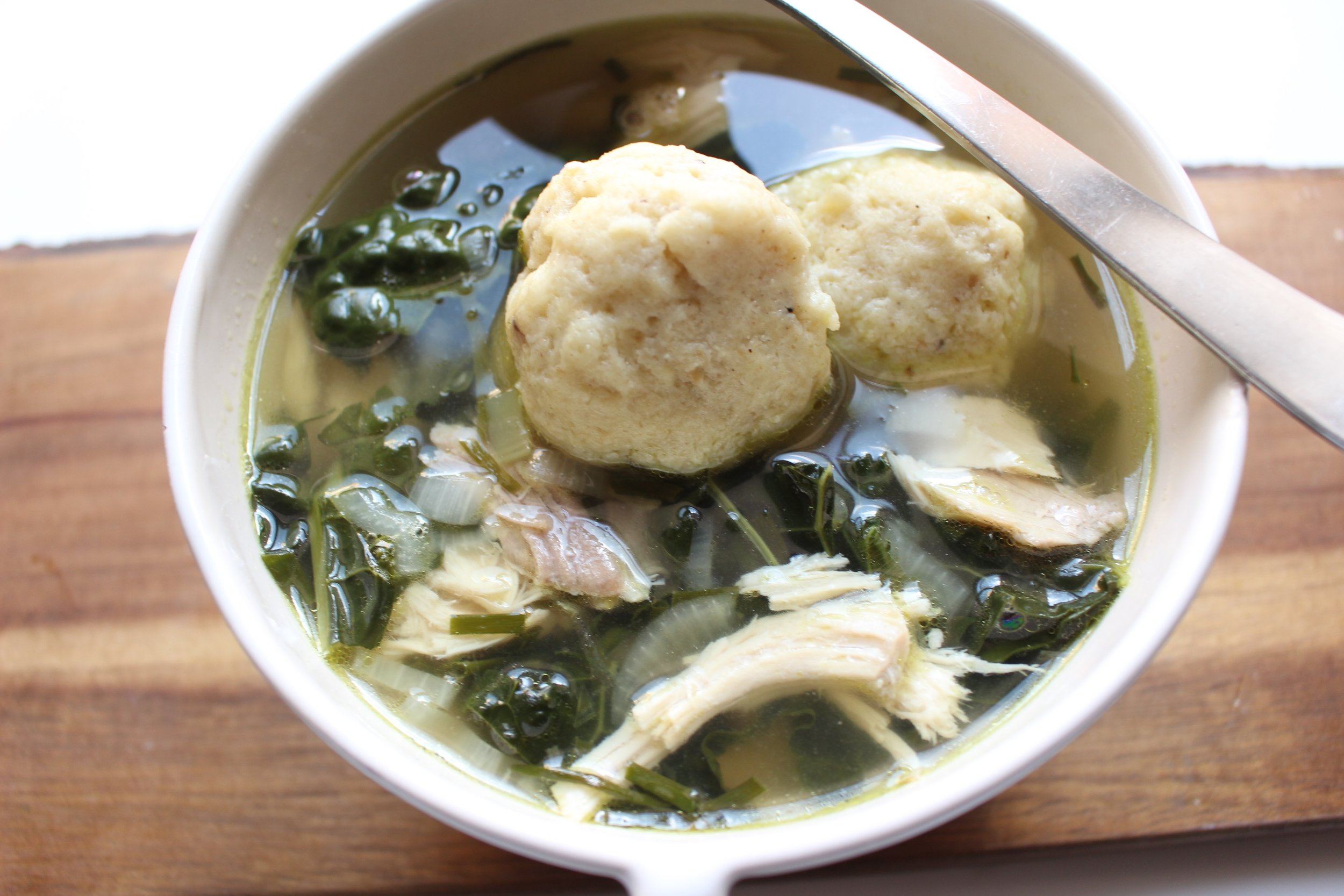 Green Matzo Ball Chicken Soup | Me & The Moose. This soup is a full meal with protein and greens mixed with light and fluffy matzo balls for Passover and any time. #meandthemoose #matzoballsouprecipes #passoverrecipes #soup #kale #chickensouprecipes #healthycomfortfood