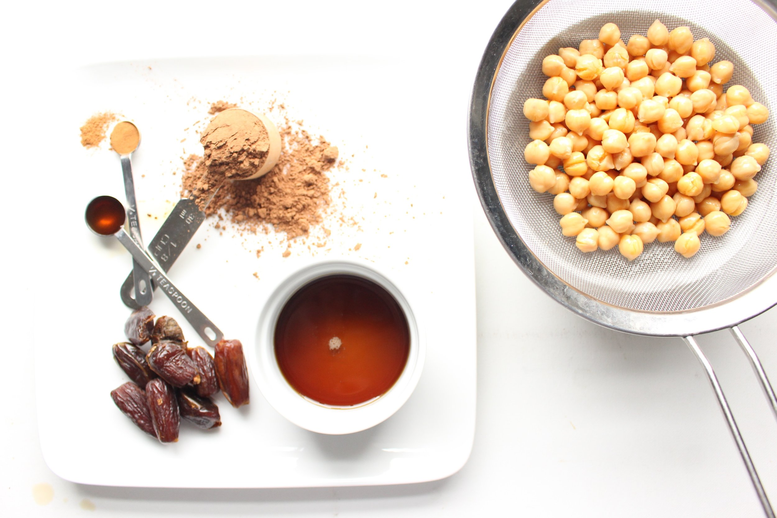 Chick peas, dates, maple syrup, unsweetened cocoa powder, vanilla, cinnamon, and salt.