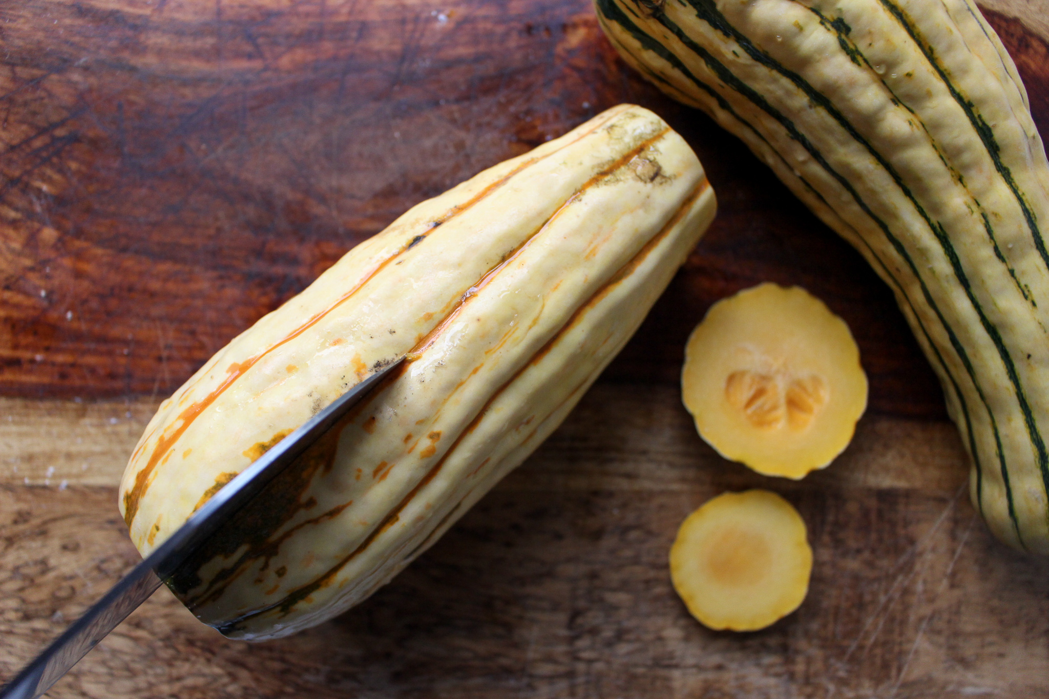 Delicata Squash is easy to prepare because it doesn't require peeling. #meandthemoose #delicatasquash #healthycaesar #salad #fallsalad #thanksgivingsalad #thanksgivingrecipes