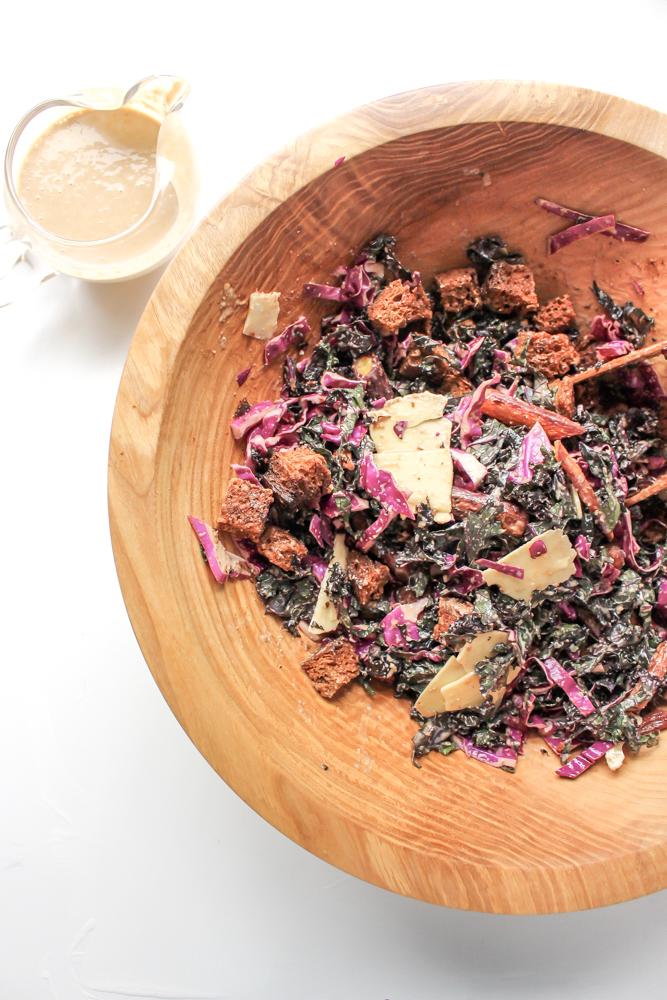 Purple kale and cabbage salad | Me & The Moose. A simple winter salad with greens, cabbage, roasted vegetables, and garlicky pumpernickel croutons tossed with a shallot vinaigrette is as filling and cozy as a salad can be. #meandthemoose #salad #wintersalad #saladrecipes #vegetarian #kale #cabbage #purplefoods