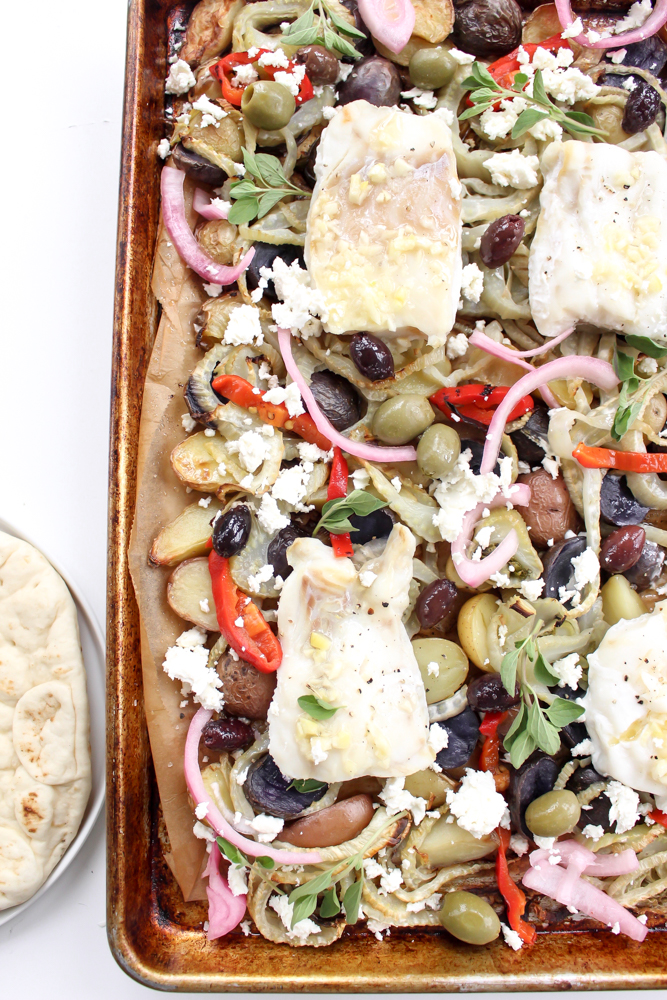 Sheet pan dinner: White Fish with Potatoes and Fennel | Me & The Moose. This one pan wonder dinner is ready in 40 minutes and features fish and veggies dressed up with all the sweet, salty, creamy, briny, and crunchy toppings you could want. #meandthemoose #sheetpandinner #onepandinner #dinnerrecipes #Mediterraneandiet #fishrecipes #pescatarianrecipes #glutenfreerecipes #dairyfreerecipes