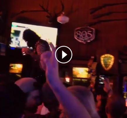 Ape on bar.