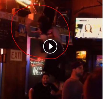 Ape jumping off bar.