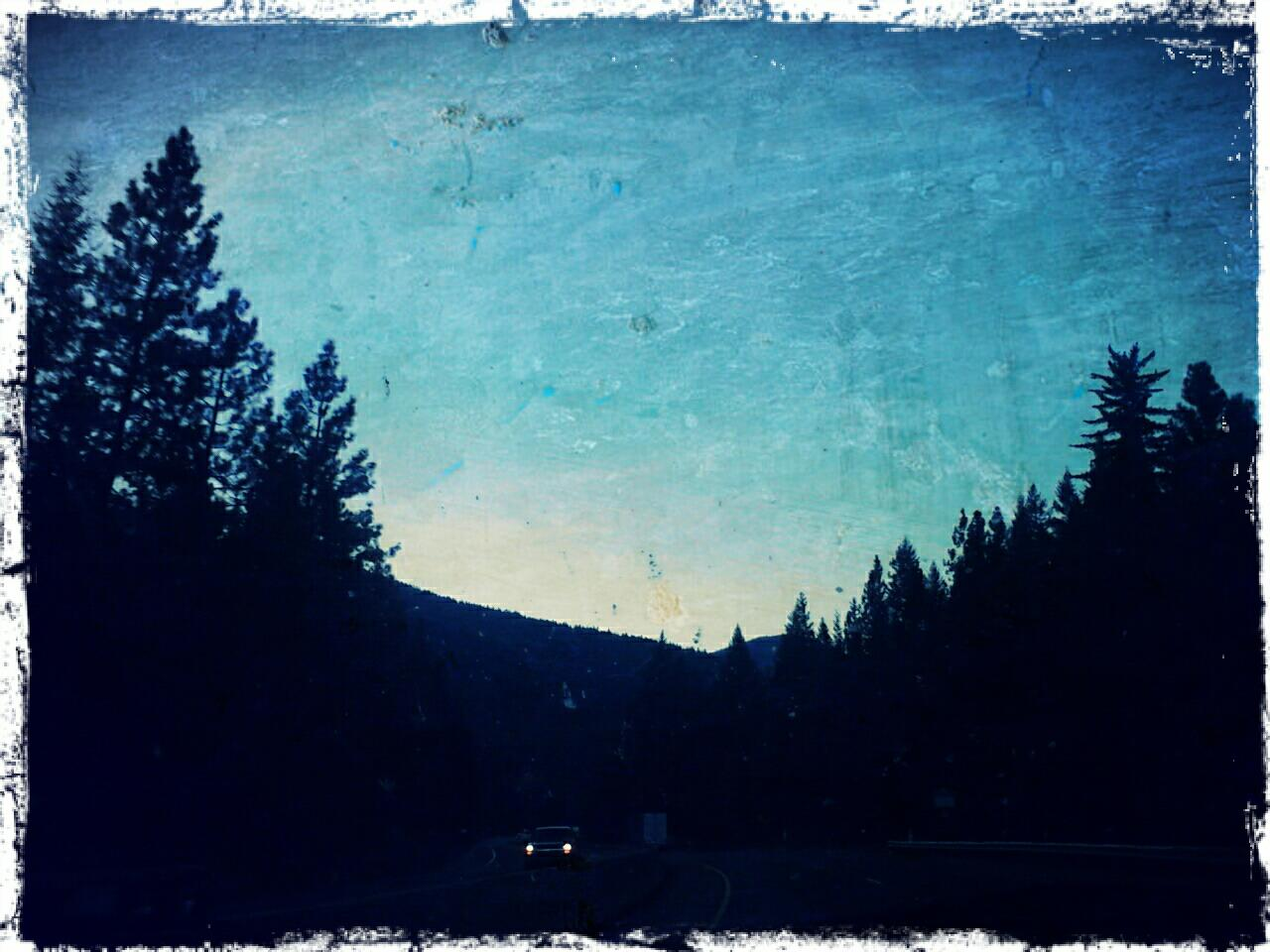 I took this photo from the van during Red Eye Junction's first show on our Oregon  mini tour on Sept 8, 2012. We were en route to Cottage Grove after the gig and we spent that night in the van by a gorgeous, secluded river. That was the trip where I learned to actually sing.