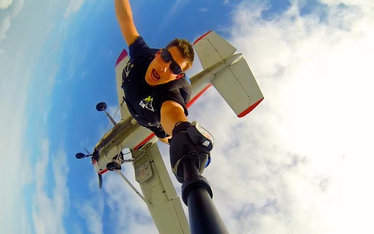 """I live my life for the green light   : the flick of a switch; the glow of a bulb; the command of """" GO ."""" Eighteen feet to my rear represents a sanctuary for fear, second thoughts, and security; two inches to my front represents exhilarating freedom.  242 times  last year I chose 'Option B' – skydiving from altitudes in excess of 13,000 feet and plummeting towards the earth at speeds over 120 miles per hour. If you truly want to live your life to the fullest, leaping out of an airplane is certainly one way of doing it.     Three years ago I made a pledge to myself that I would never half-heartedly live another day of my life. I was a 24-year old First Lieutenant on my way home from an eleven-month combat deployment in Iraq, and I was prepared to start living my life in the way that it was intended: my family and friends would become my most important priority, service to others would be my keystone, and I would  NEVER  just be a 'jumper.' I would be a ' leaper .'    In skydiving, as in life, we often use the words 'jump' and 'leap' interchangeably. But one defining characteristic sets those two actions apart:  heart . There are a lot of 'jumpers' in life: they are the people who find the courage to take the first few steps, but hesitate in life's proverbial door of opportunity; they stand up in the face of challenge, but lack the commitment to follow through and affect change; they record small achievements as large successes, but leave behind their greater aspirations because of fear or doubt.      In 2015, DO NOT just be a jumper.      Reassess your goals in life. Reset your priorities if necessary. And then  ATTACK  every day with the confidence and enthusiasm as if it were your last.      Show    the people you love how much they truly mean to you.  Give  more of yourself to others in ways that make both of you stronger. Accept life's inevitable challenges as  opportunities  rather than misfortunes and grow from each experience.  Go all in!  Close old doors behin"""
