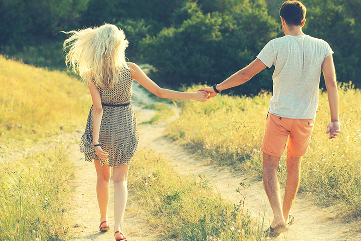 stock-photo-young-couple-in-love-together-on-nature-in-summer-210820717.jpg