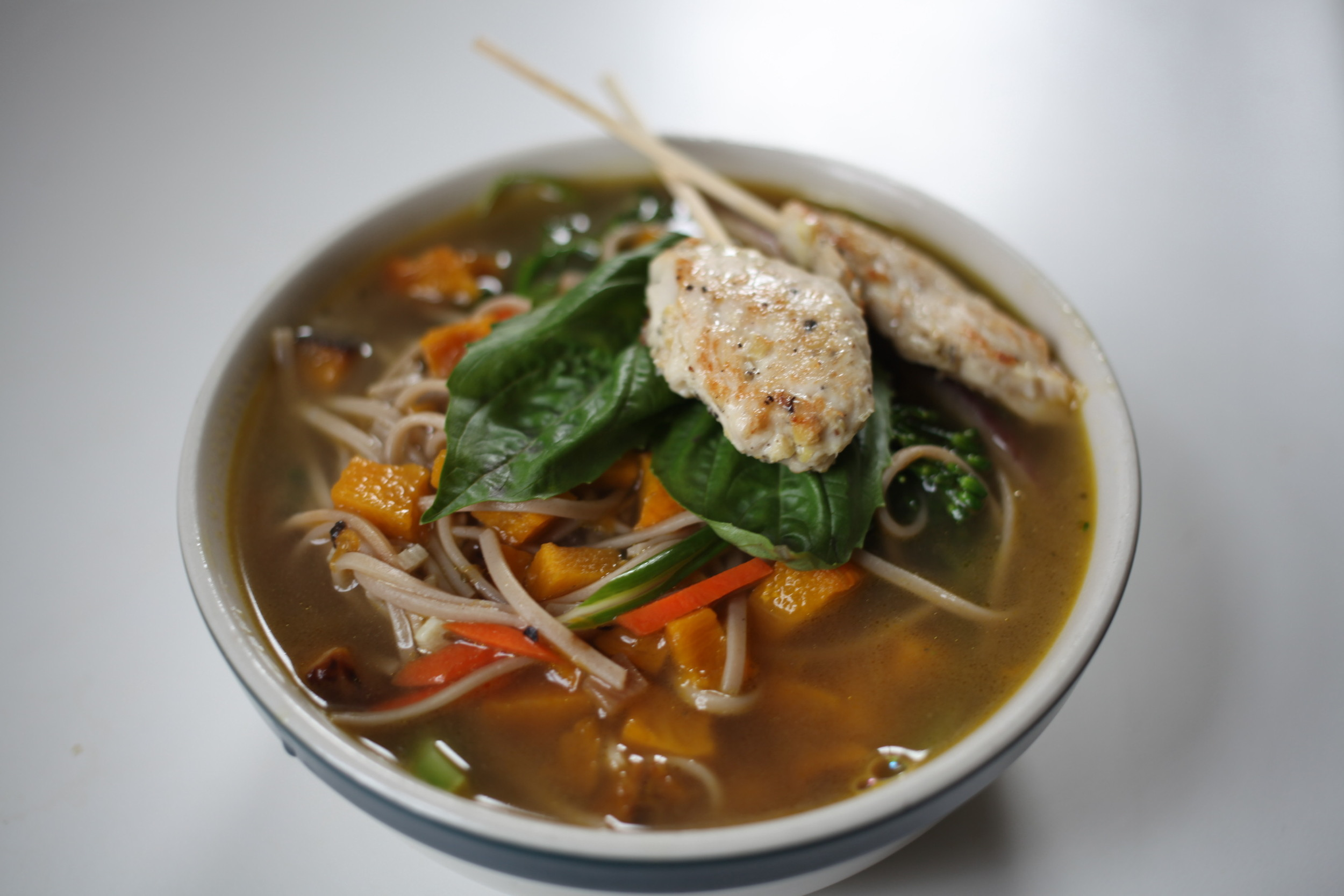 Soba Noodle Soup with butternut squash, carrots, pork braised onions, basil and Lemongrass Ginger Chicken Skewers