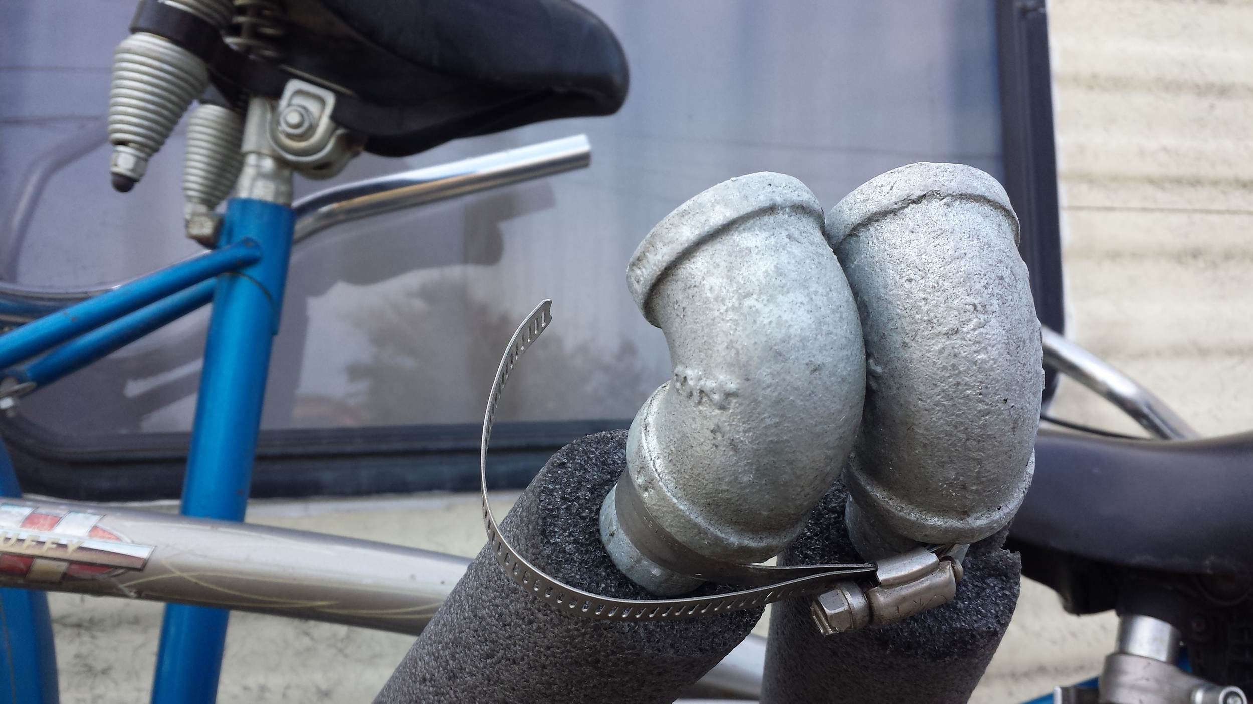 """This is the smaller of the 2 steel locking fasteners. If we had more time we would have found a 10"""" reverse threaded pipe to use as the top bar, but in interest of time, we just made it a triangle"""