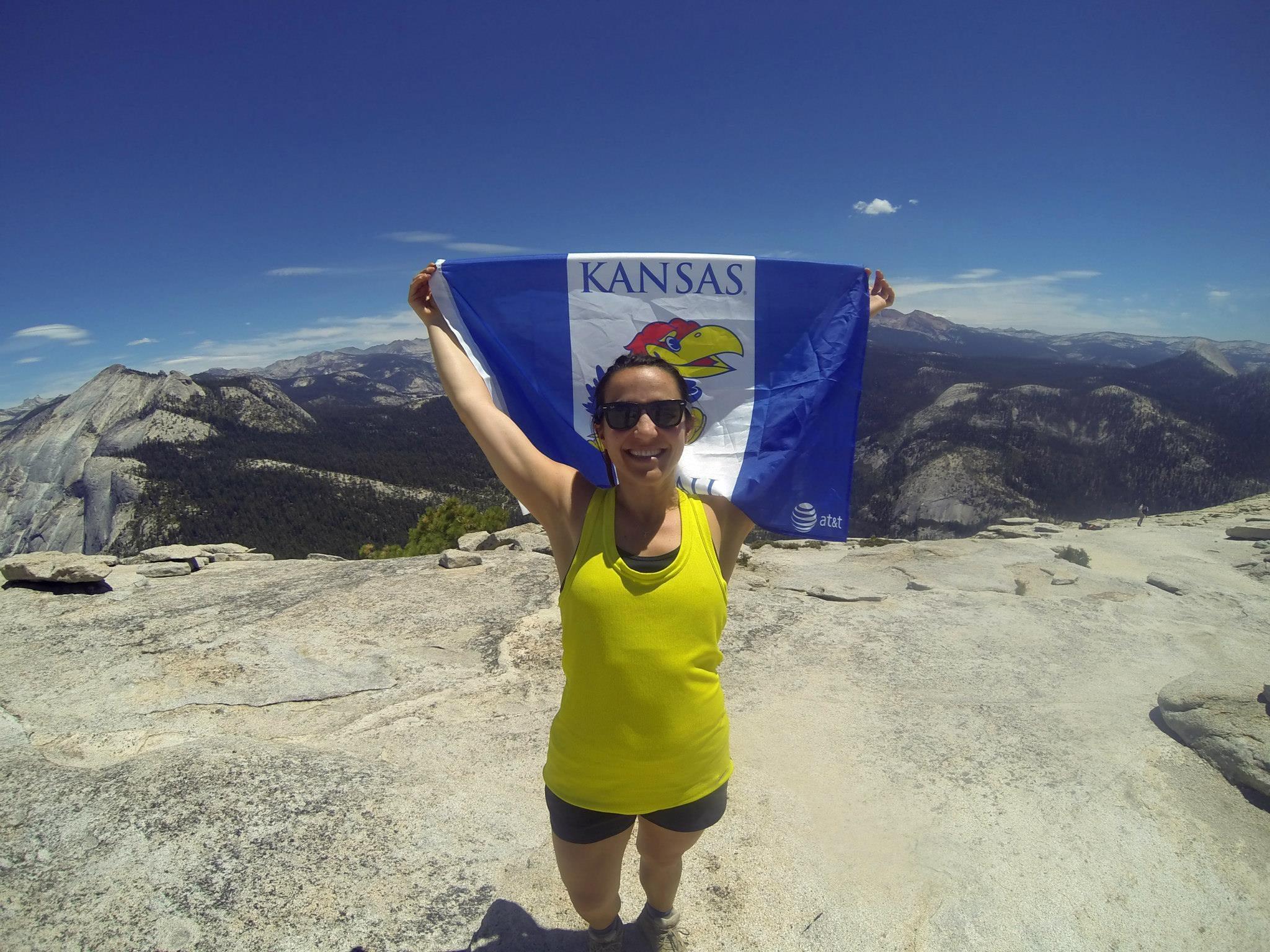 Blair showing Kansas Pride at the top of Half Dome, Yosemite.      Photo Credit: Erik Anderson