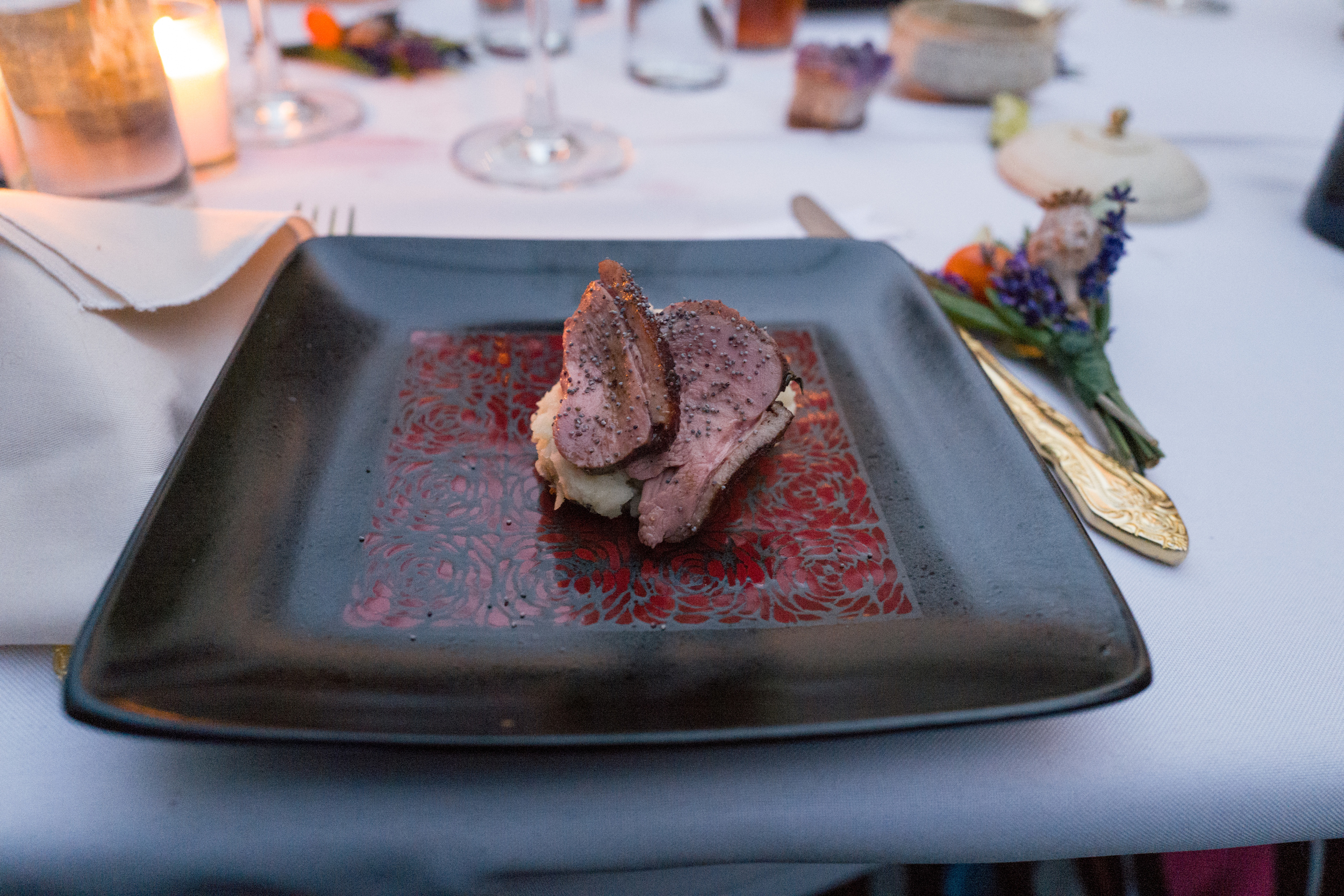 Peking Style Duck Breast on Mashed potatoes draped with toasted poppy seeds. Photo by Victoria Smith.