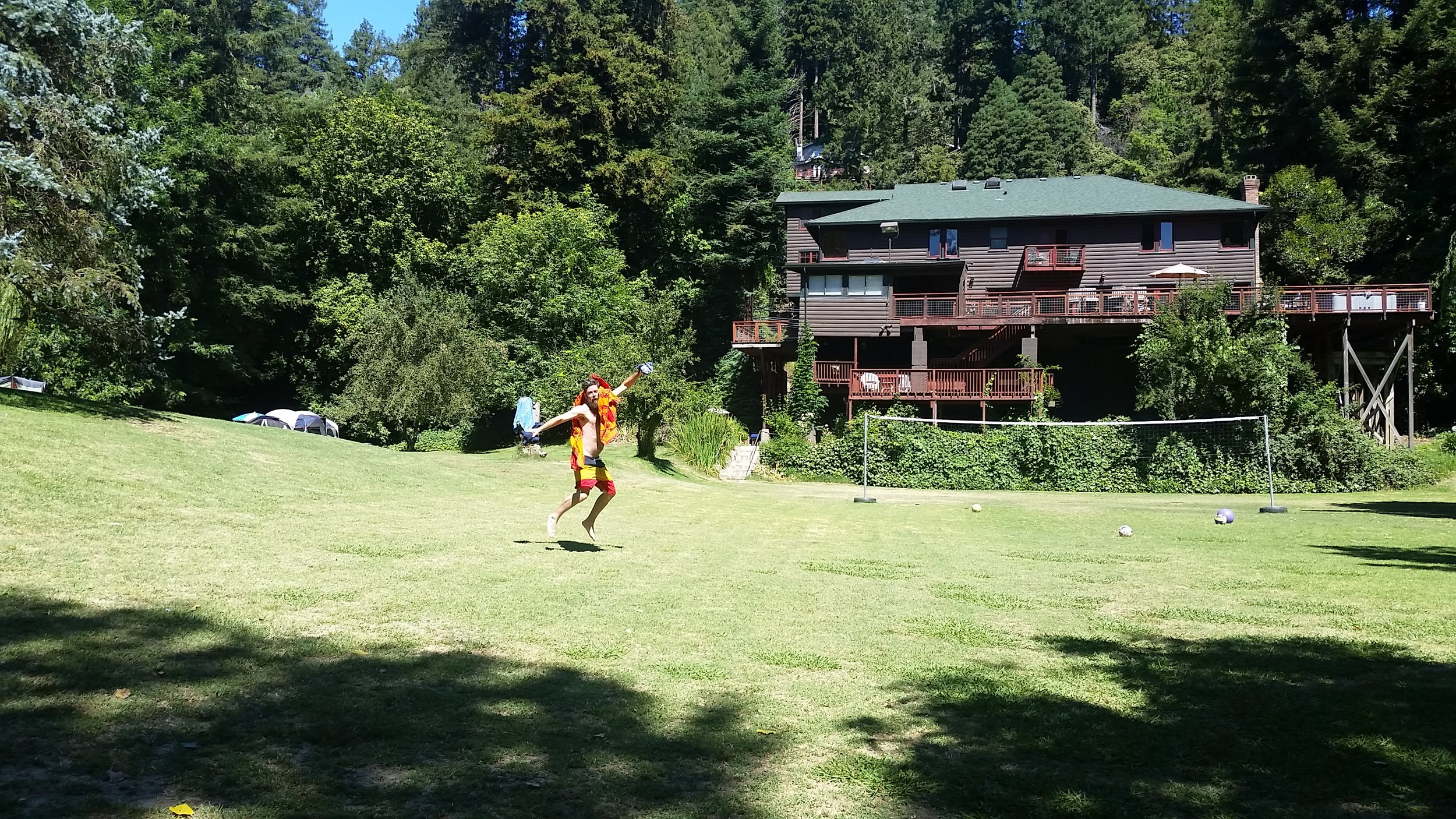 An excited Erik on the glorious lawn of Guerneville Lodge.