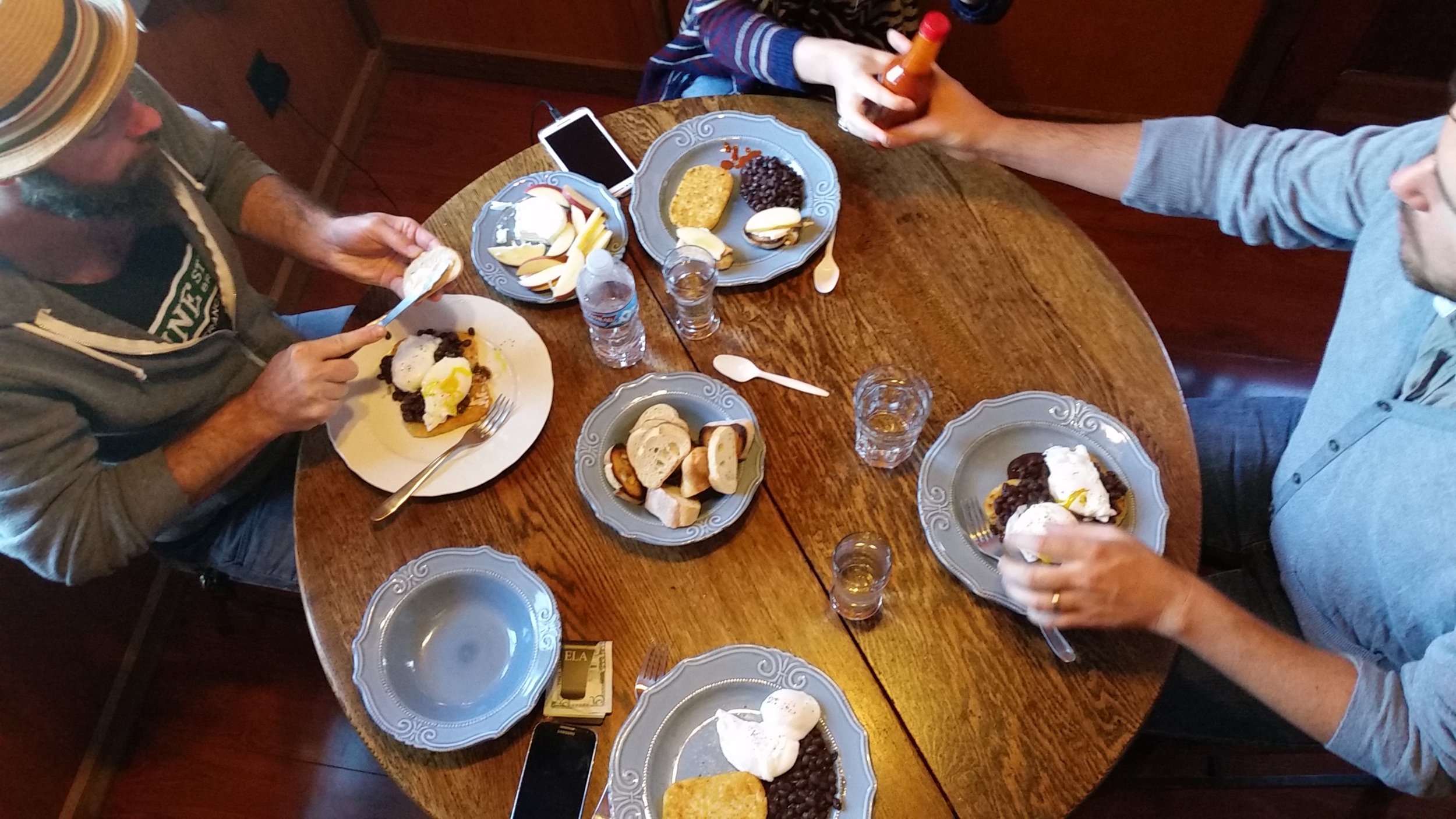 Eating breakfast made of gas station ingredients around the kitchen table at our adorable little cottage at the Jenner Inn. Poached eggs, black beans with sea weed, hashbrown patties,baguette and goat cheese toast.