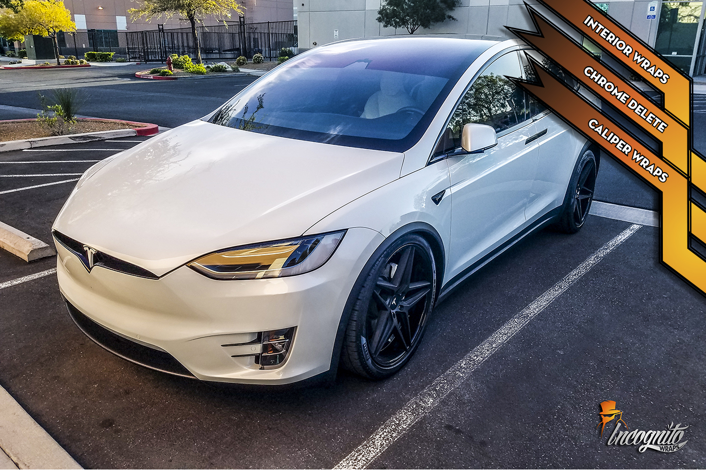 Tesla Model X - White Chrome Delete, Caliper Wraps, and Piano Black interior