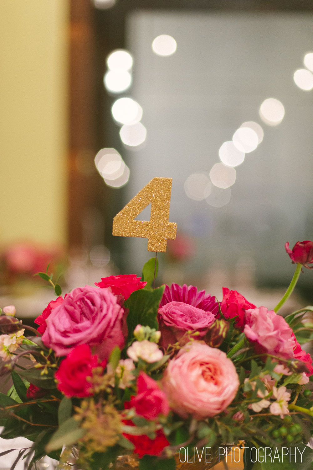Gold glitter table numbers Photo by  Olive Photography