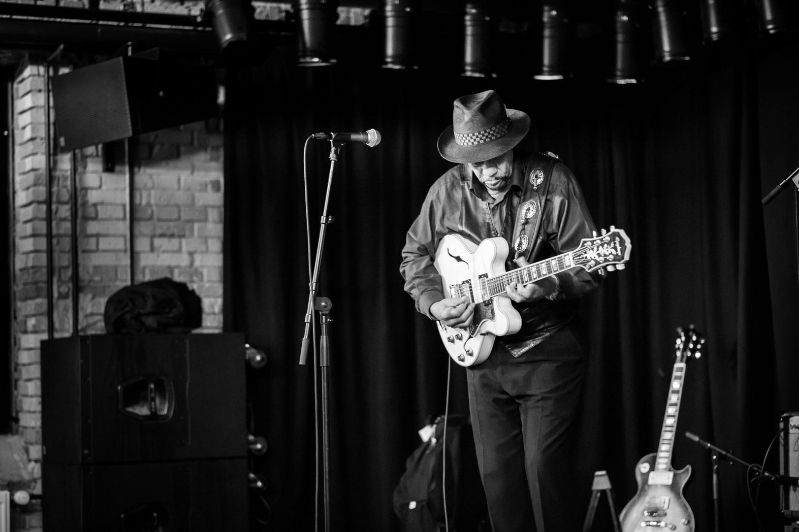 John Primer tuning his guitar