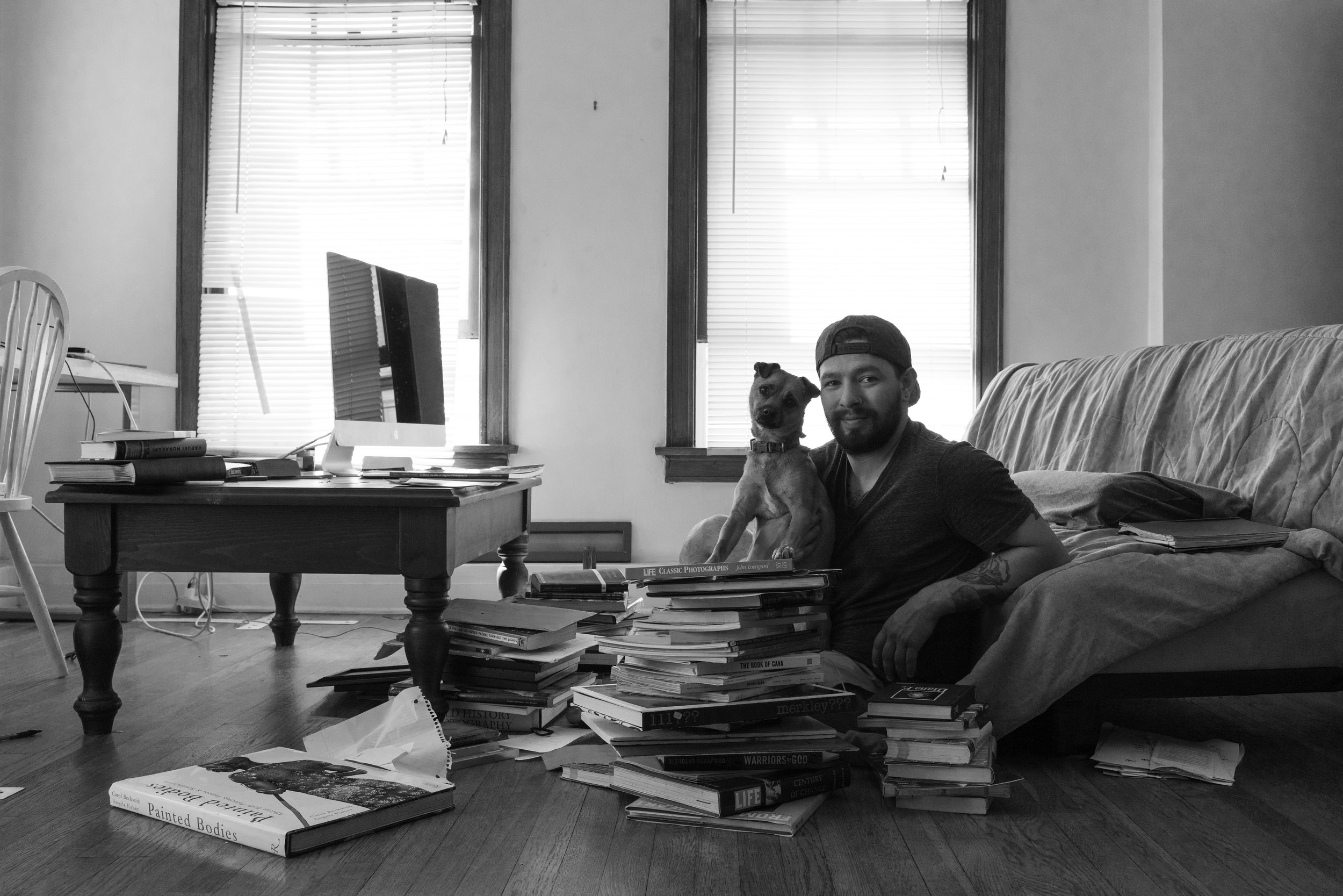 self-portrait of me and my Puppy Rocky, boy does she love photography books!