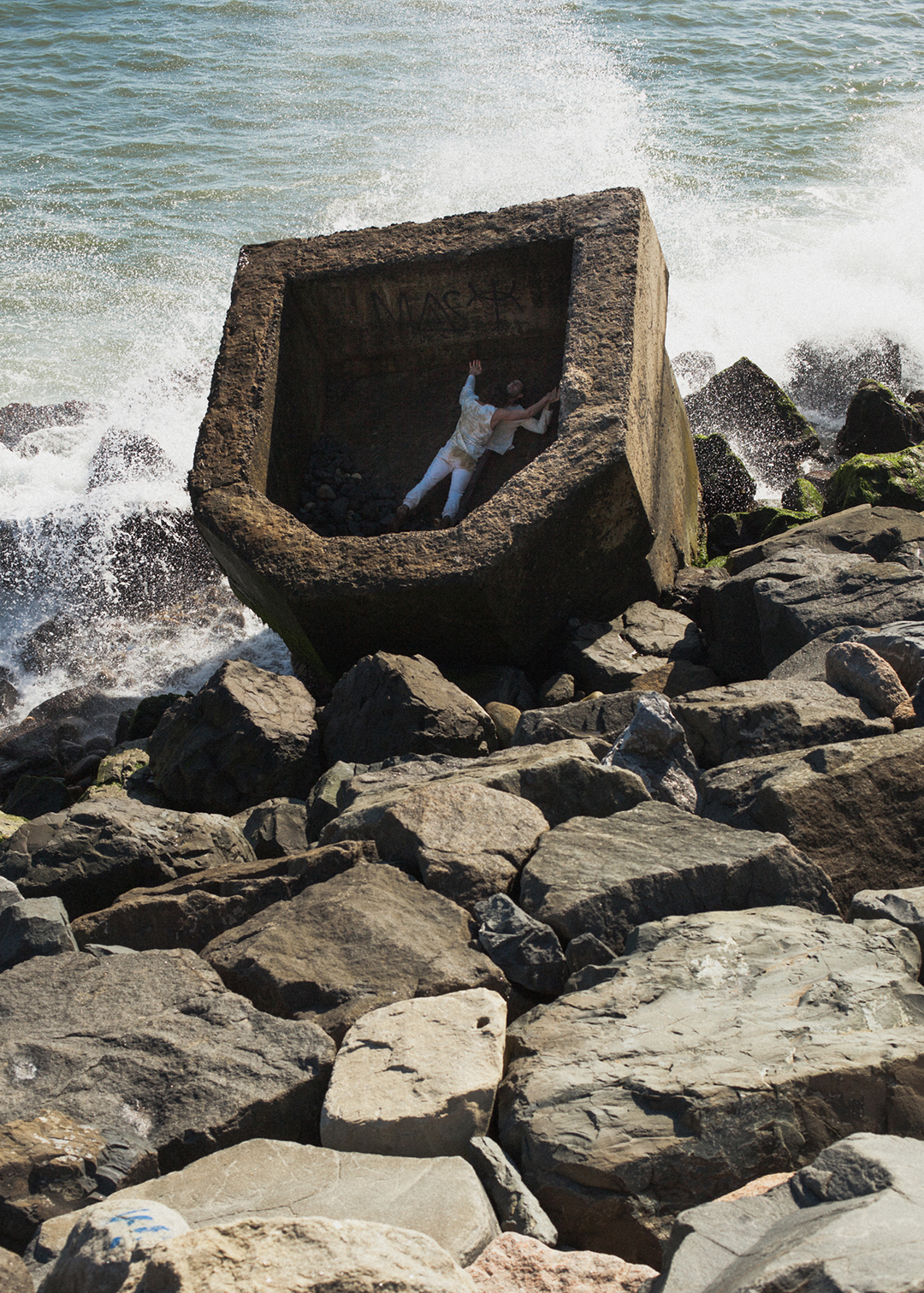 Documentation of research in and around a remnant of a bunker that is lodged in the ocean off the coast of Montauk, NY.