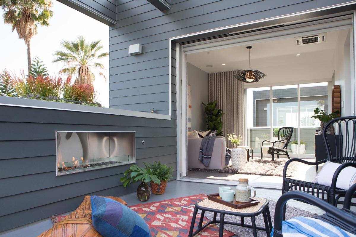 11_outdoor living rattan leather fireplace indoor outdoor pocket door mid century lounge relaxation los angeles.jpg