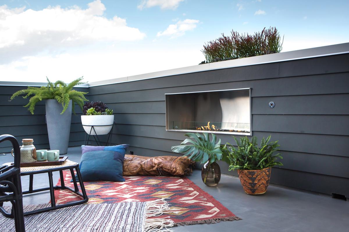 16_outdoor living rattan leather fireplace indoor outdoor pocket door mid century lounge relaxation los anglees.jpg