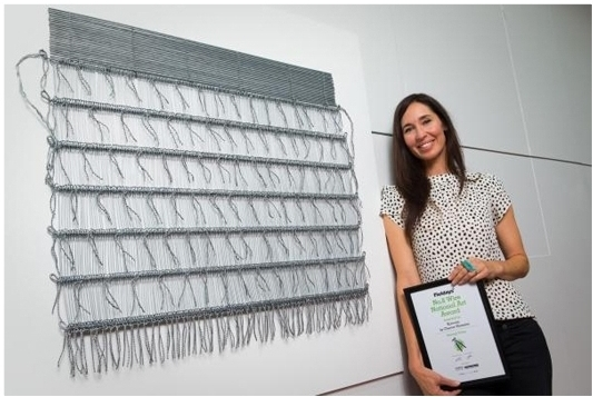 Fieldays No.8 Wire National Art Award Second place winner Cherise Thomson with 'Korowai' - now permanently on display at the beautiful new National Fieldays Society Headquarters in Mystery Creek.