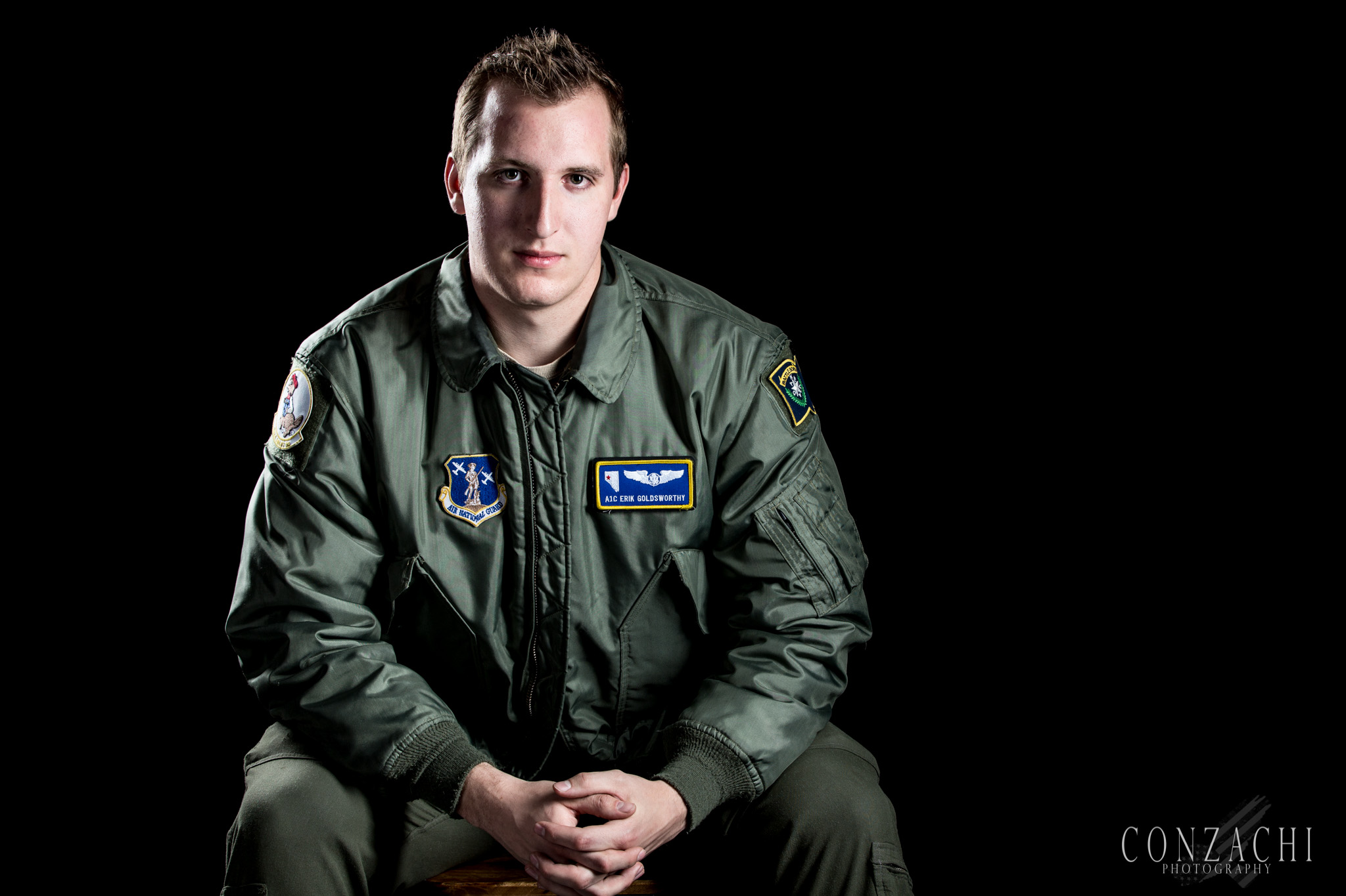 "Erik Goldsworthy, 21 Branch: Air Force Status: Air National Guard MOS: Loadmaster, 1A251 Years Served: 2014-Present Deployments: Coming Soon  His Story: ""I am a 3rd generation service member at the beginning of my career. I joined the Nevada Air National Guard right out of high school. My father works at the same base as I do and I hope that I can live up to his colossal reputation and create my own legacy at the same time.""  From the Author: Erik was a pleasure to work with. Sharp, honorable, and eager to serve his country. Erik has not deployed as of yet, but that does not make him any less of a brother in arms to me than any other veteran. When you meet someone like Erik, and hear them speak and see their commitment, you just know they will do great things in their life. Good luck in your military career Erik, I look forward to talking to you again.  Thank you for your service Erik, and Happy Veterans Day."