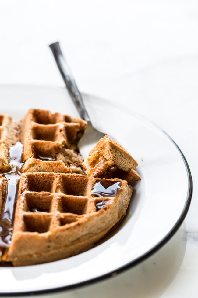 Maple syrup topped Cinnamon Apple Buckwheat Waffles | edibleperspective.com