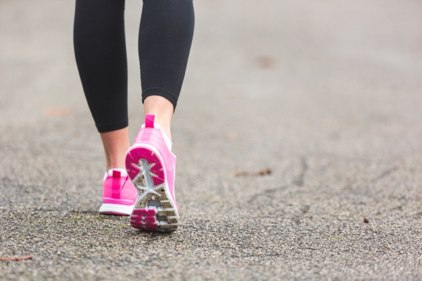 Walk with a friend or work with a personal trainer