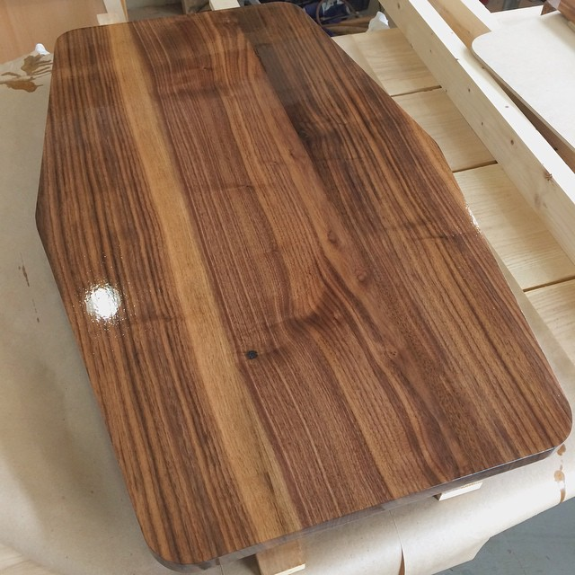 The always exciting first coat of finish. Using poly on this so it can take some abuse #walnut #woodshop #woodworking #handmade #handmadefurniture #furnituredesign #design #skanadesign