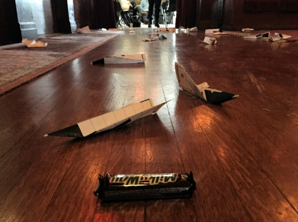 """Staff """"launched"""" their ideas and closest to the Milky Way bar won a prize. The good news is that our staff had a ton of great ideas to get us started. The bad news is that our staff is severally lacking in paper airplane making skills."""