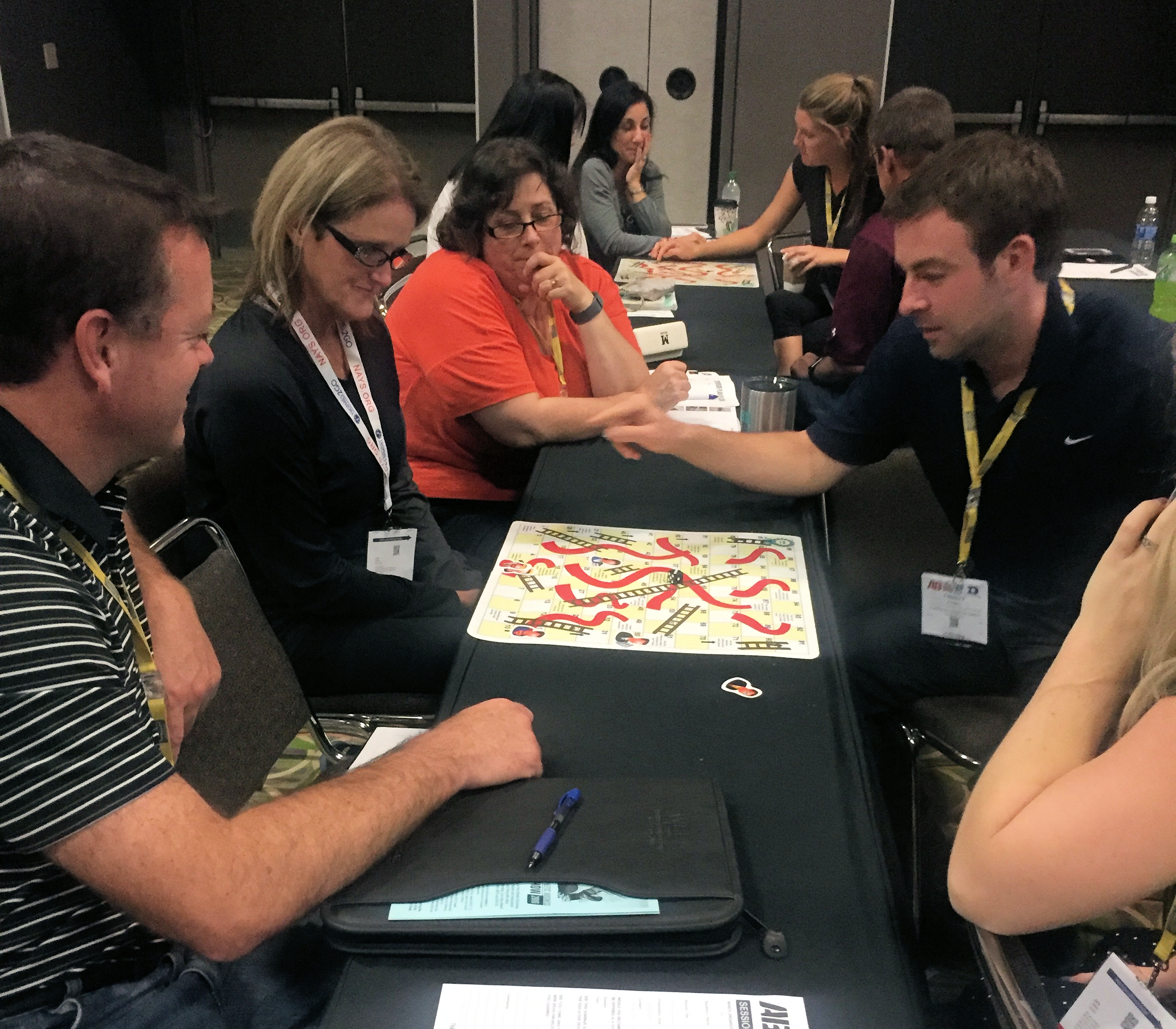"""bobbi created a custom """"supervisory chutes and ladder"""" game for her breakout session on dealing with difficult employees at the athletic Business conference."""